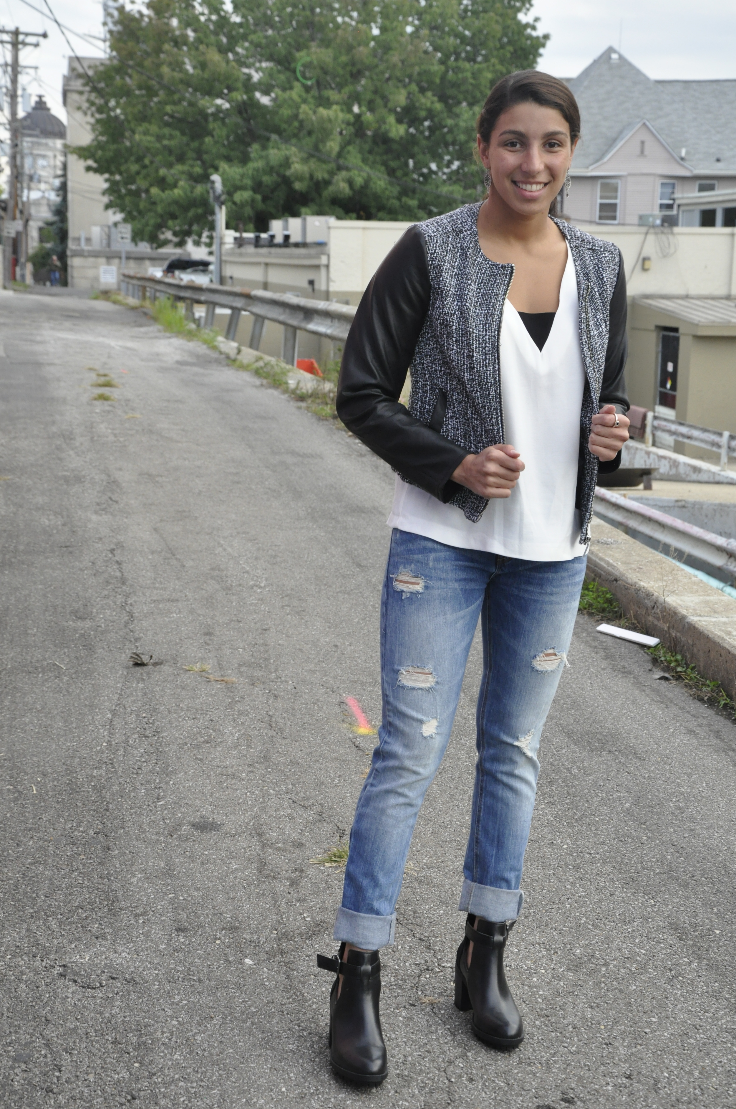 A cute pair of slightly torn jeans are an asset to any ladies' closet! Of course, try to stay away from the overwhelmingly ripped jeans. These Zara bottoms help to make this look more casual while still maintaing the chic factor that we are all going for. The light wash of the jeans takes the severity out of the all black and white top/jacket.