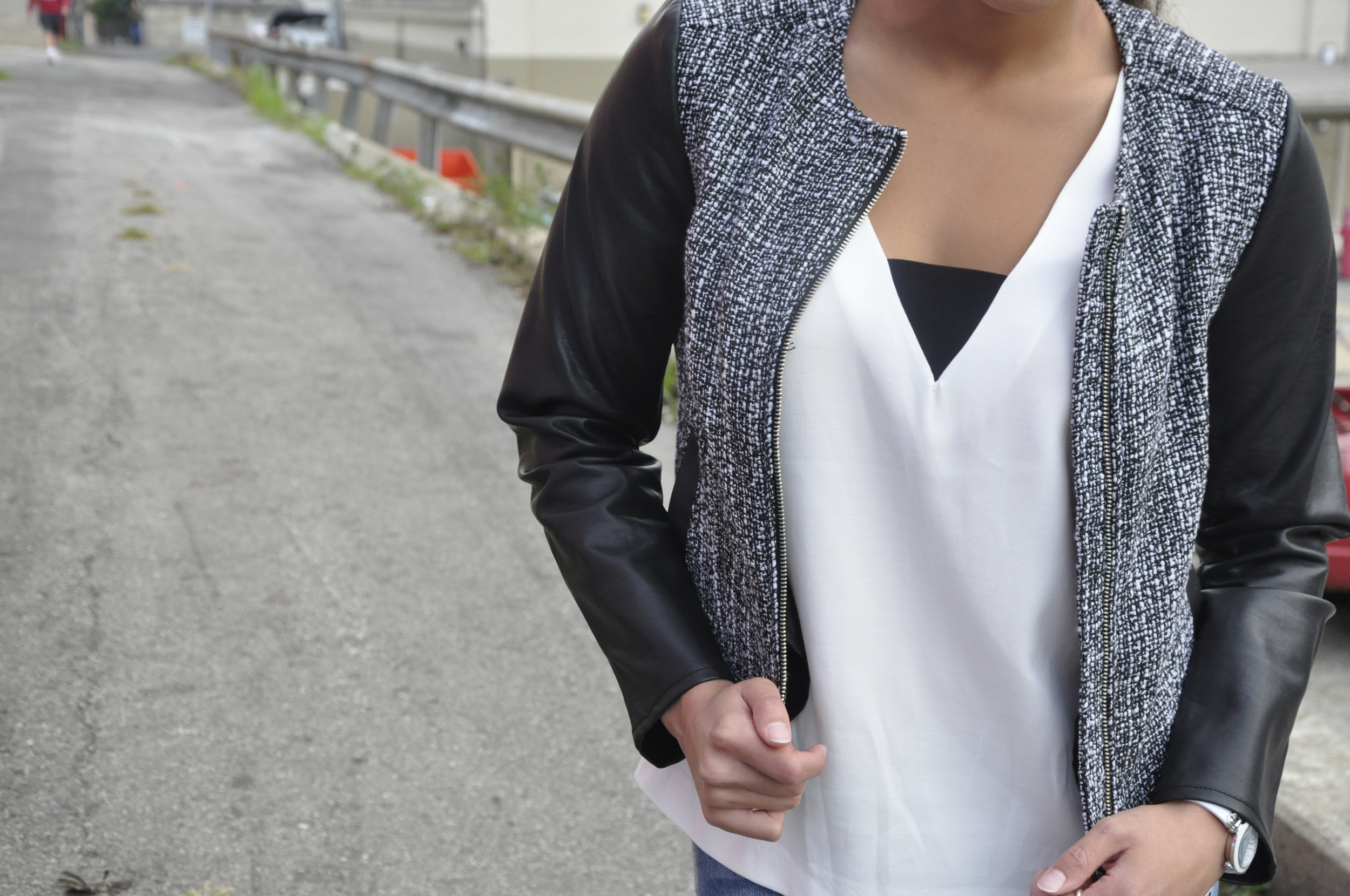 This top is a staple in my wardrobe! It's can be casual, it can be dressy, but most importantly, it is versatile. It's black and white, so you can wear it with many different color and style bottoms. The V-neck paired with the contrasting horizontal black fabric adds a modern edge, which compliments the jackets modern look.