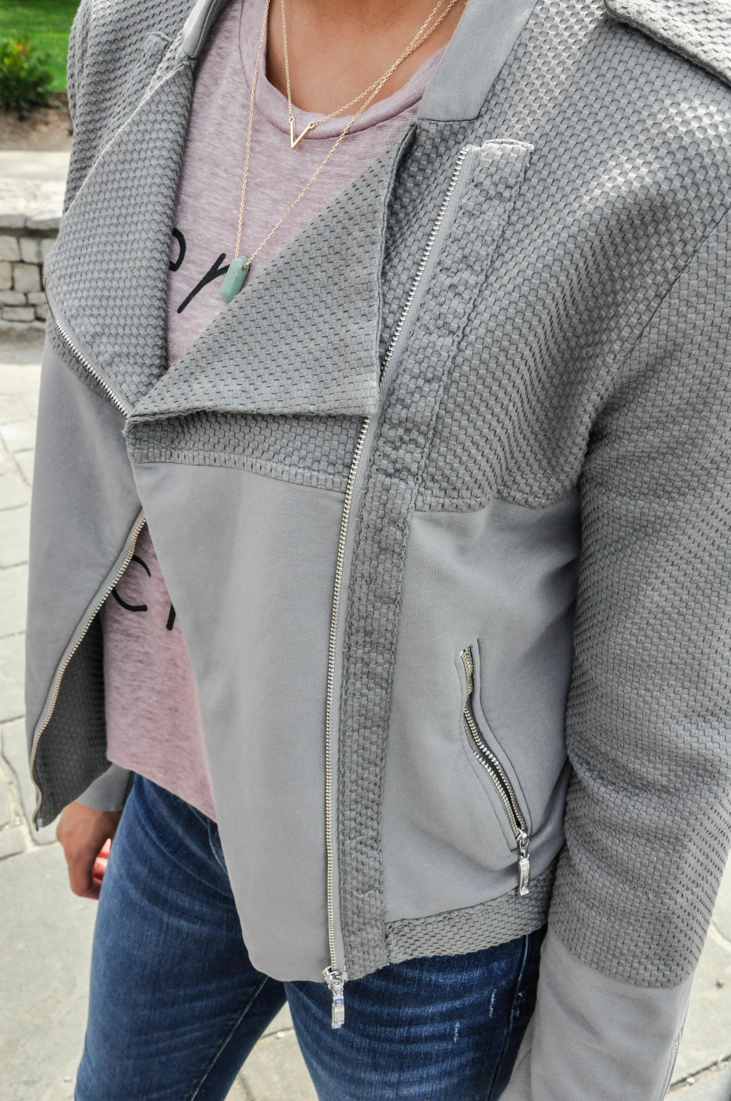 A few things that really drew me into this jacket are the faded olive green color as well as its unique texture. The woven detail on the sleeves and collar makes this jacket stand out from the usual asymmetrical zippered biker jacket not only in style, but also in texture.