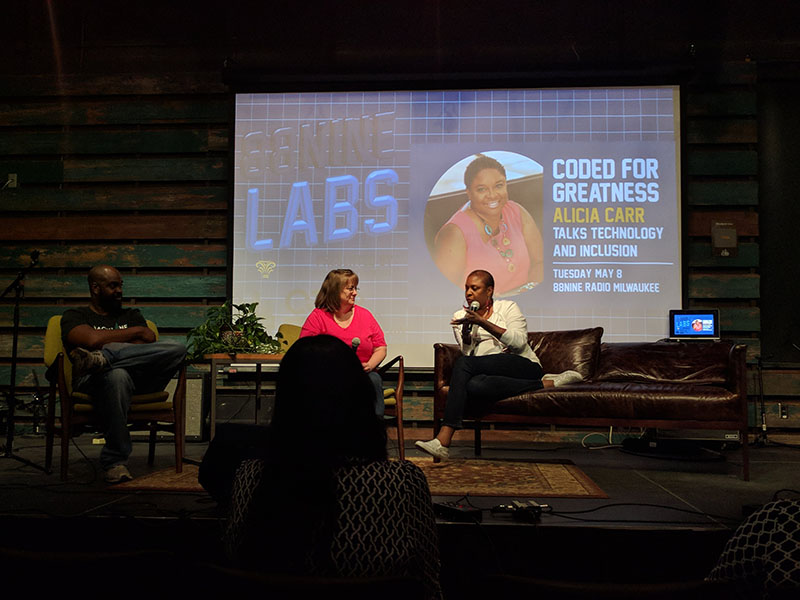 Cynthia Smith, a Senior Engineer from Northwestern Mutual, and Tarik Moody, a DJ from 88.9 Radio Milwaukee, discuss Alicia's work with her. Alicia has jokes, making Cynthia, Tarik, and the audience frequently break out in laughter with her.