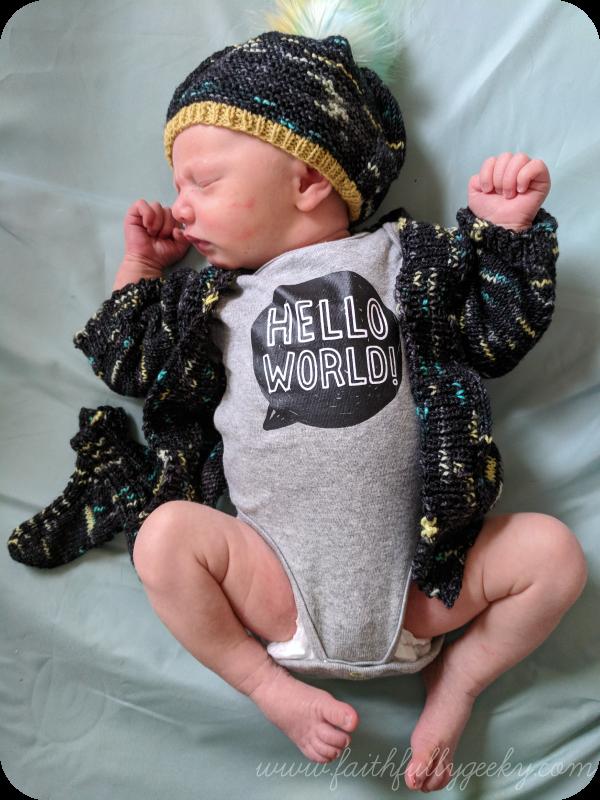 Sweater:  Newborn Vertebrae   Hat:  Barley Light   Pompom:  Fffabuknits   Socks:  Baby Mitten Socks   Yarn: Yarn vs Zombies,  Cascade Heritage Sock