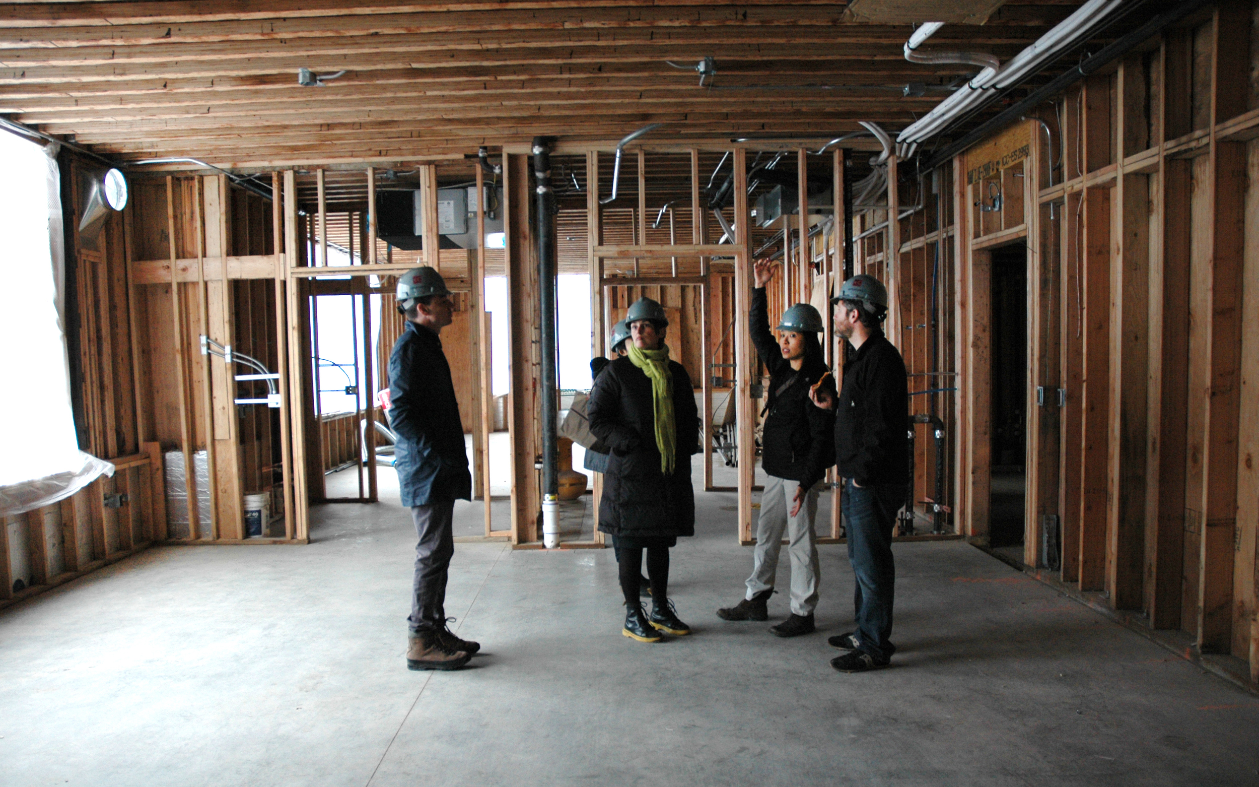 Gladys explains the layout of the pre-k classrooms. We started with the idea of interconnected classrooms- visually and physically students and teachers could pass through adjacent classrooms, with safety and privacy taken into account.Small pockets were created between these classrooms for either storage, study, meeting and other amenities. We were very pleased with the ample light all classrooms received, even in the lower floors.