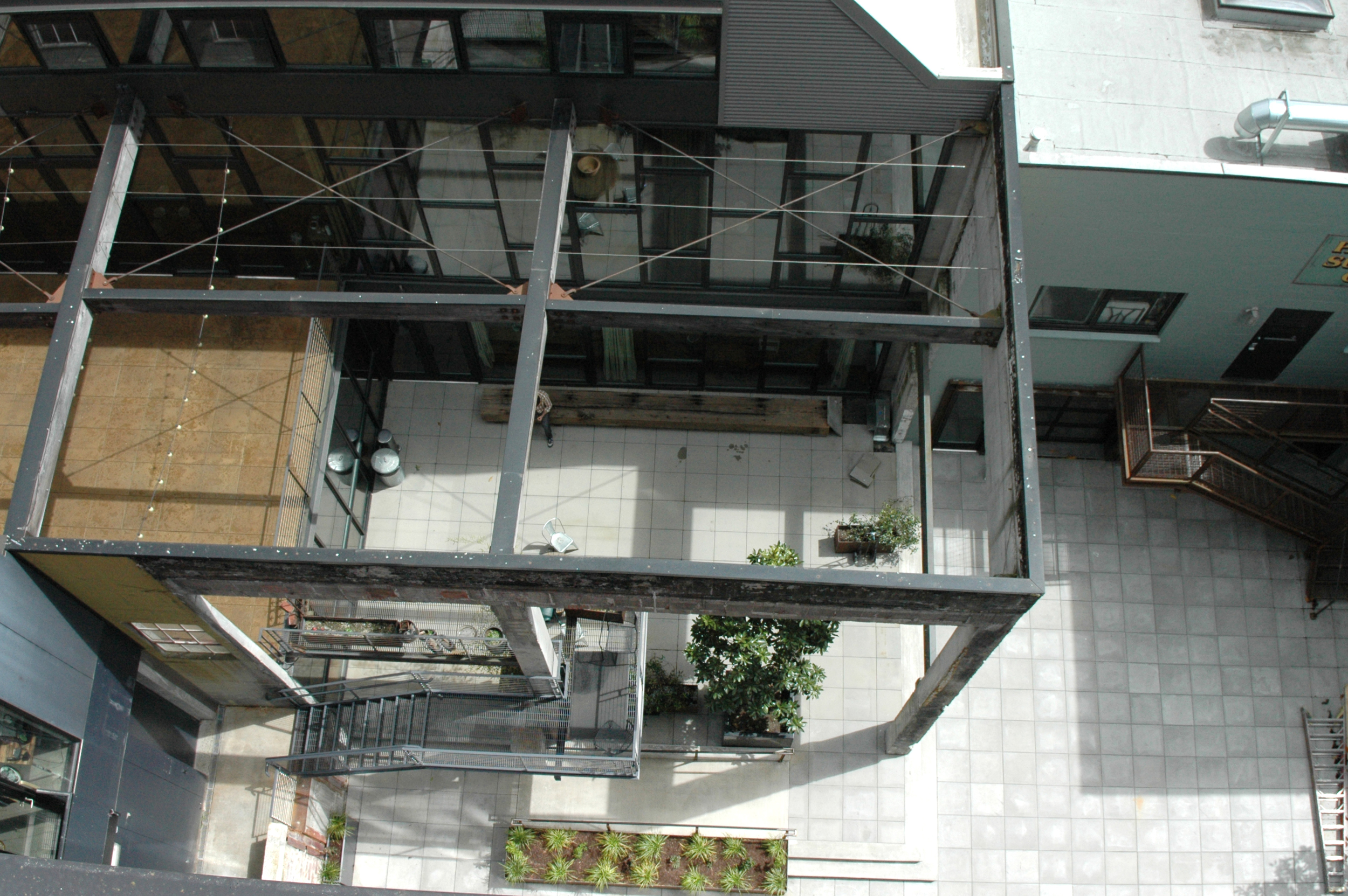 """View from the top of Chophouse Row down to the adjacentPacific-Chop building. Leaving the skeleton makes a great """"outdoor room"""" for restaurants and offices."""