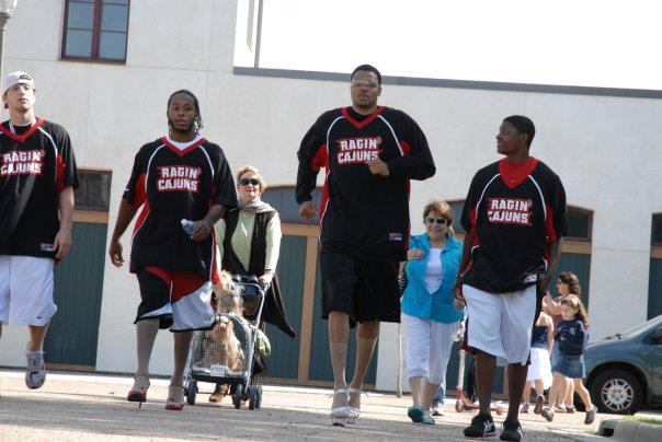 UL Athletes walk a mile in her shoes