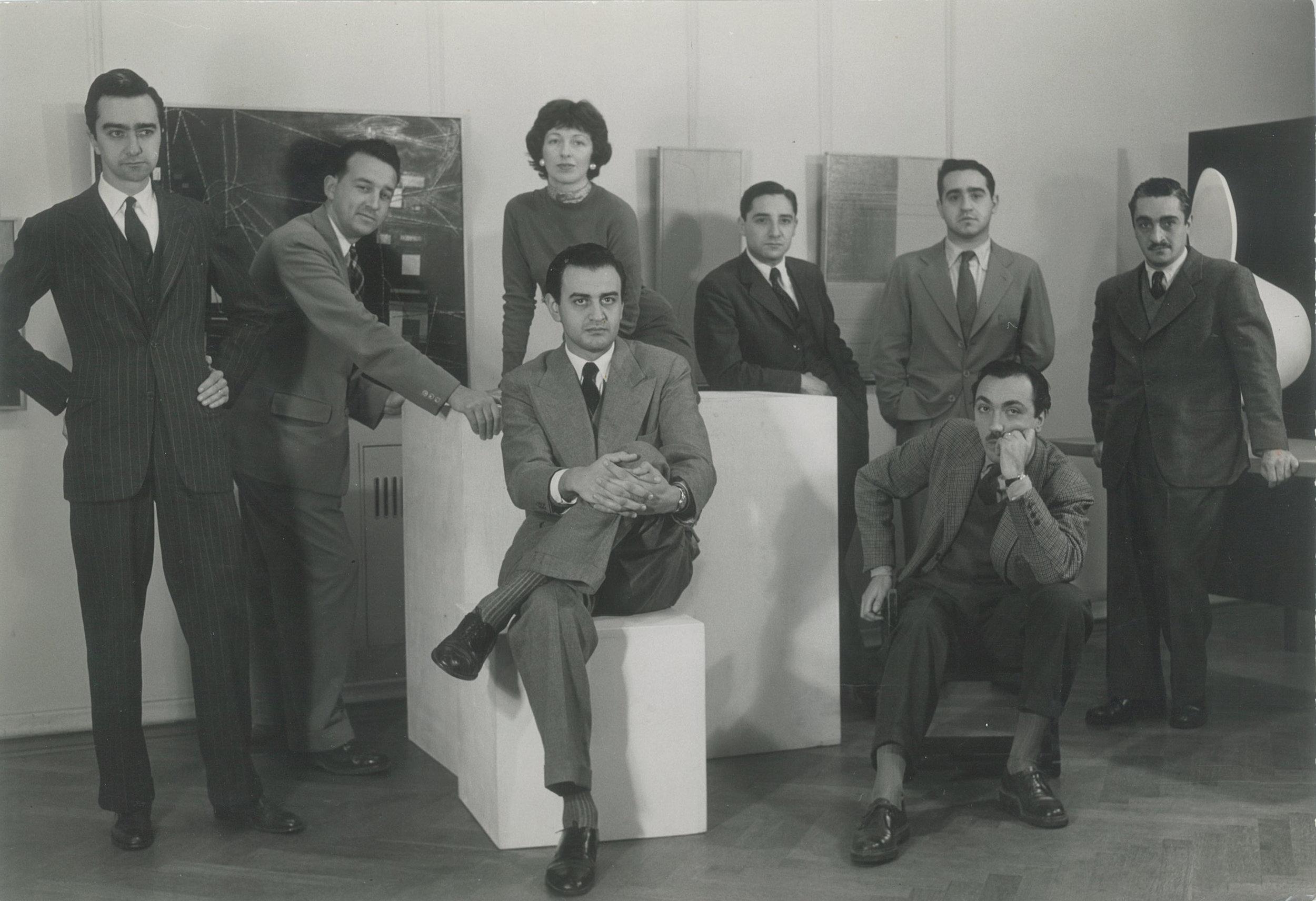Exhibition  Grupo de artistas modernos   (GAMA)  at Galería Viau, Buenos Aires, 1955.  From left to right: Miguel Ocampo, Hans Aebi, Sarah Grilo, Tomás Maldonado, Alfredo Hlito, Enio Iommi, José Antonio Fernández-Muro and Claudio Girola.  Photo: © A.Migone