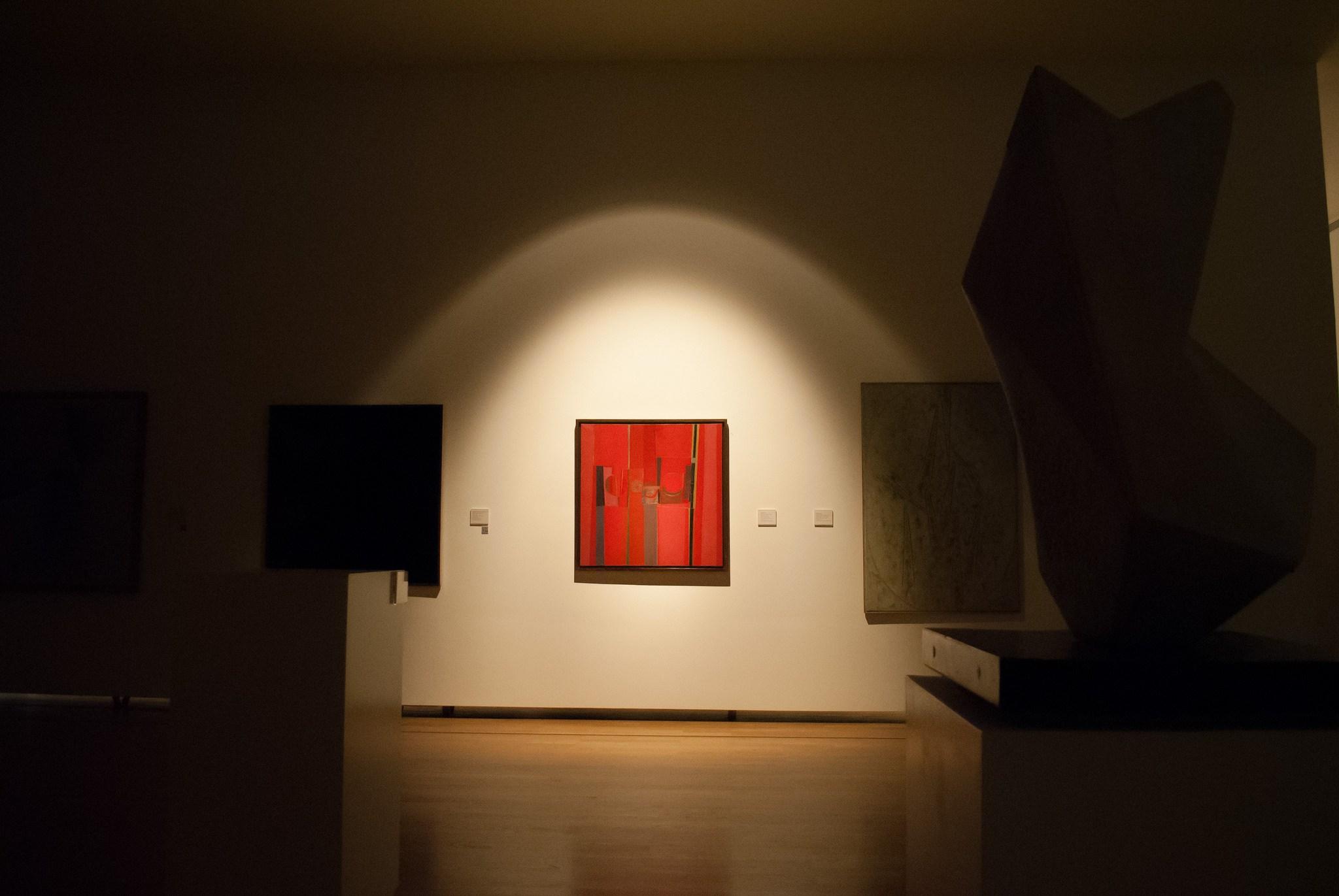 "Pintura (en rojos)  (1958), by  Sarah Grilo, illuminated during the ""blackouts"" for International Women Month at Museo Nacional de Bellas Aertes, Buenos Aires"