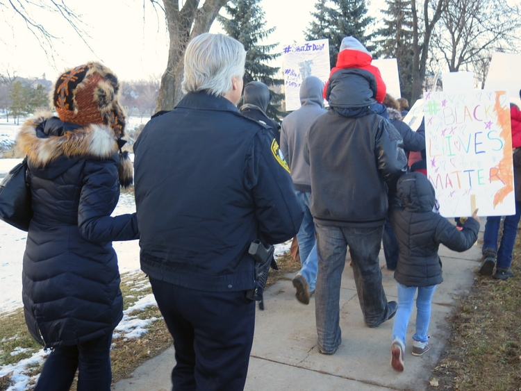 Chief Peterson walking in a rally against police brutality / 2014