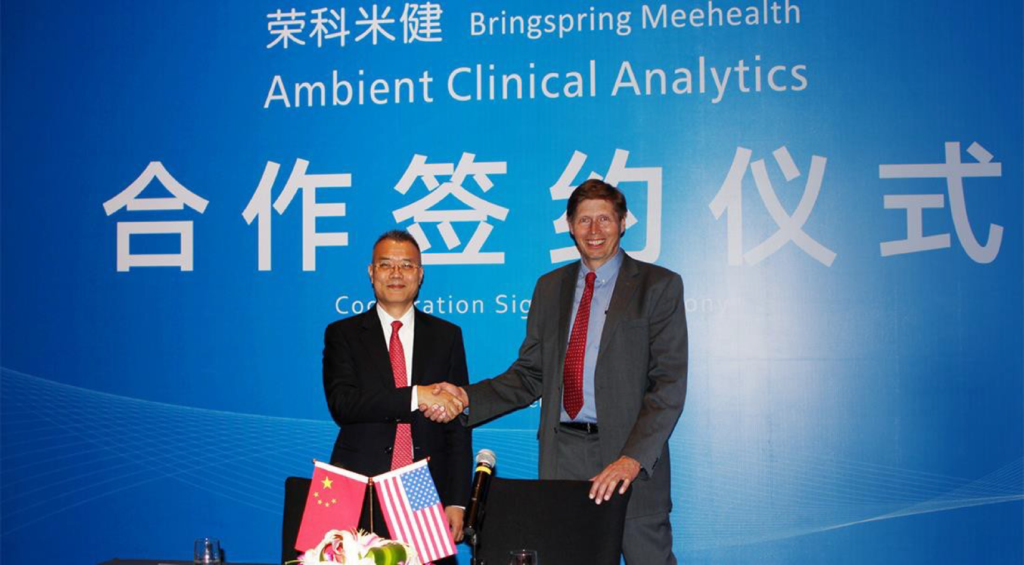 Al Berning, right, meets with Dr. Zhang Jiwu, CEO of Meehealth in China