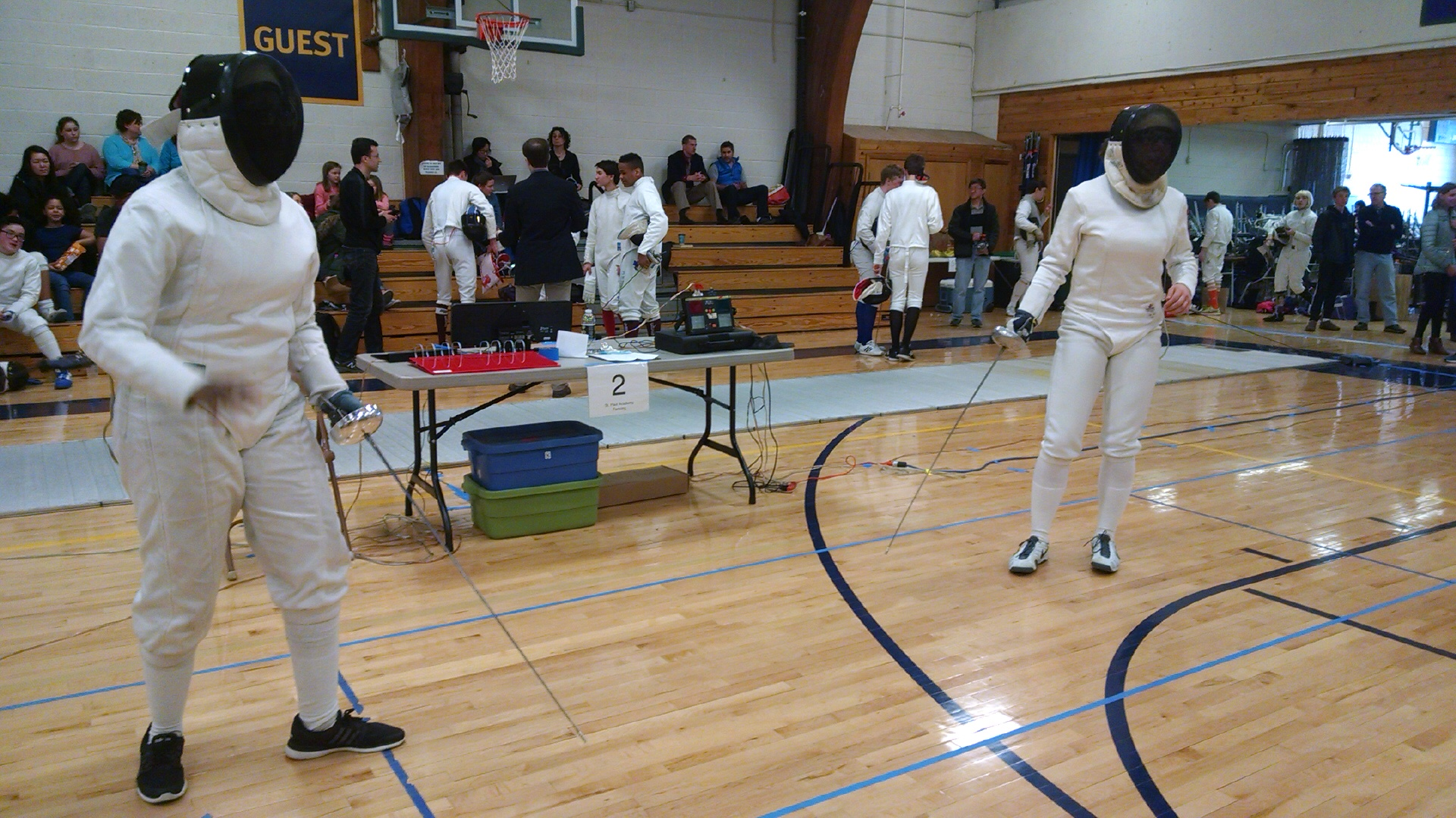 STEM Academy's Faisa Mohammed, left, prepares for a bout during the state championships this past February in St. Paul.
