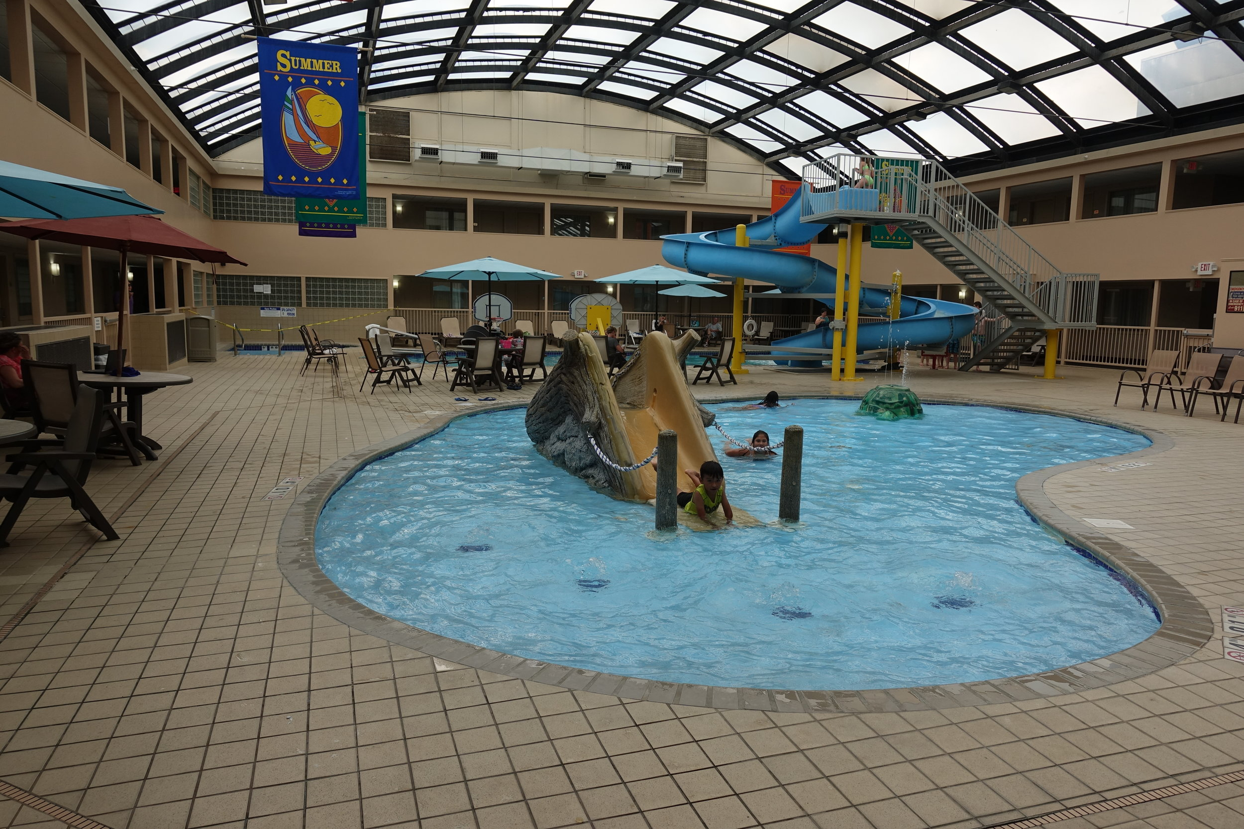 The pool at Kahler Apache Hotel features a two-story waterslide