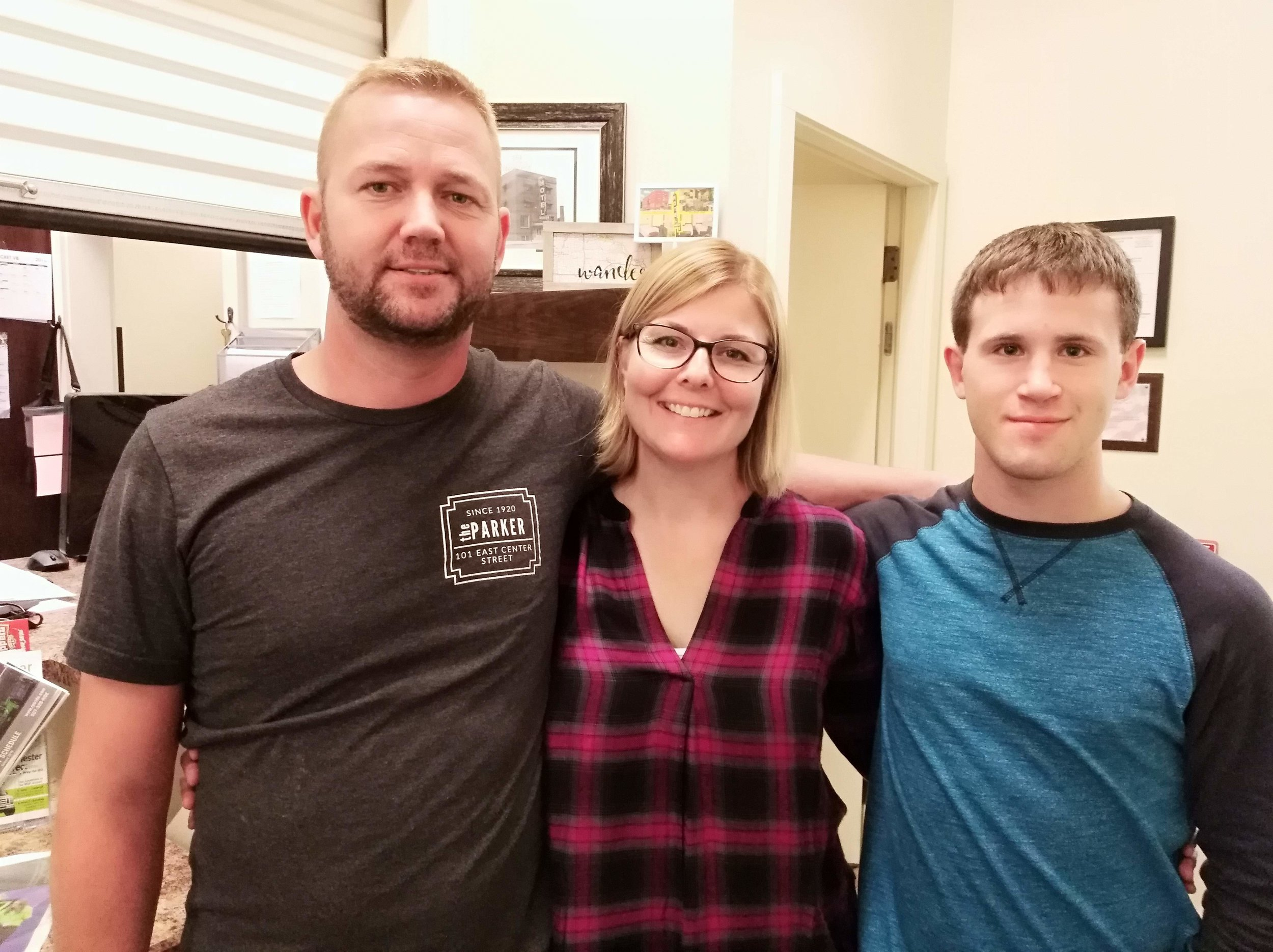 Left to right: Andy, Kari and Jared. Jared helps the couple manage their properties.