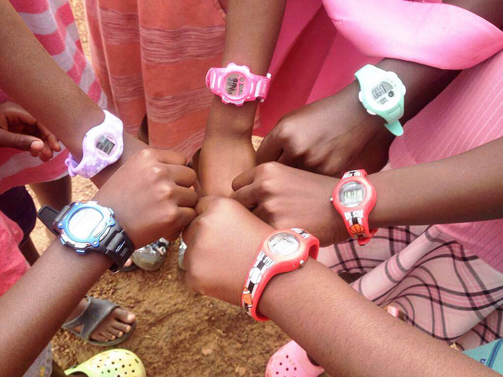 A few cherish girls showing off their donated watches