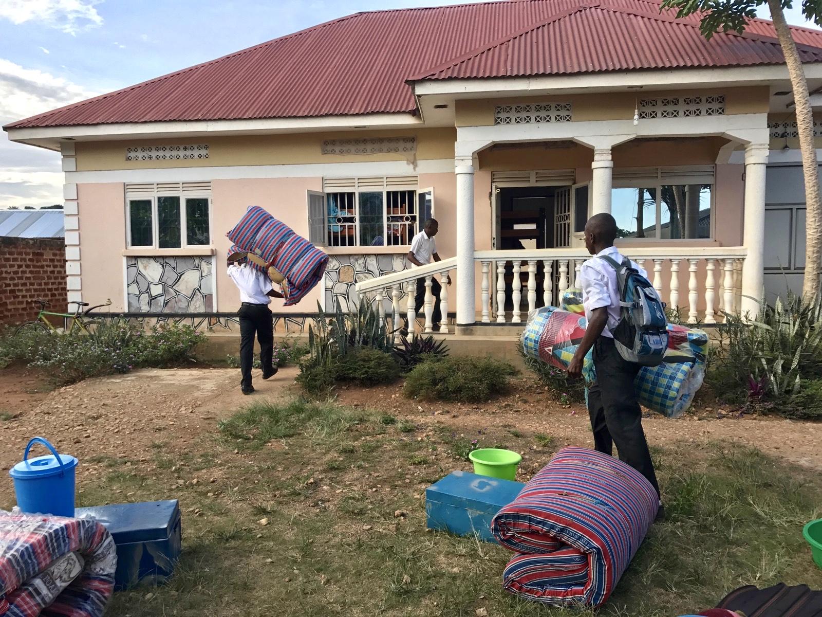 Secondary school boys moving into the boys' dormitory