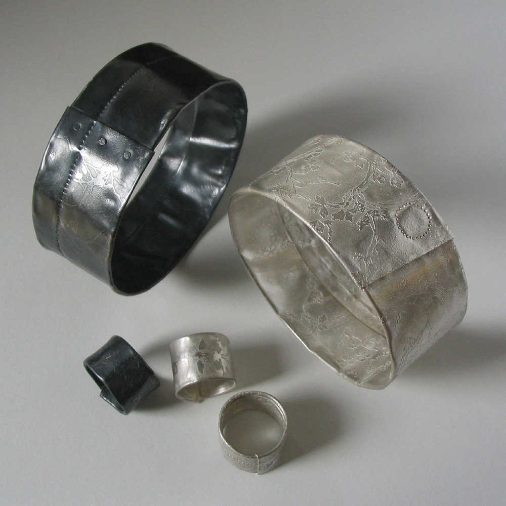 Wrapped etched silver cuffs and rings