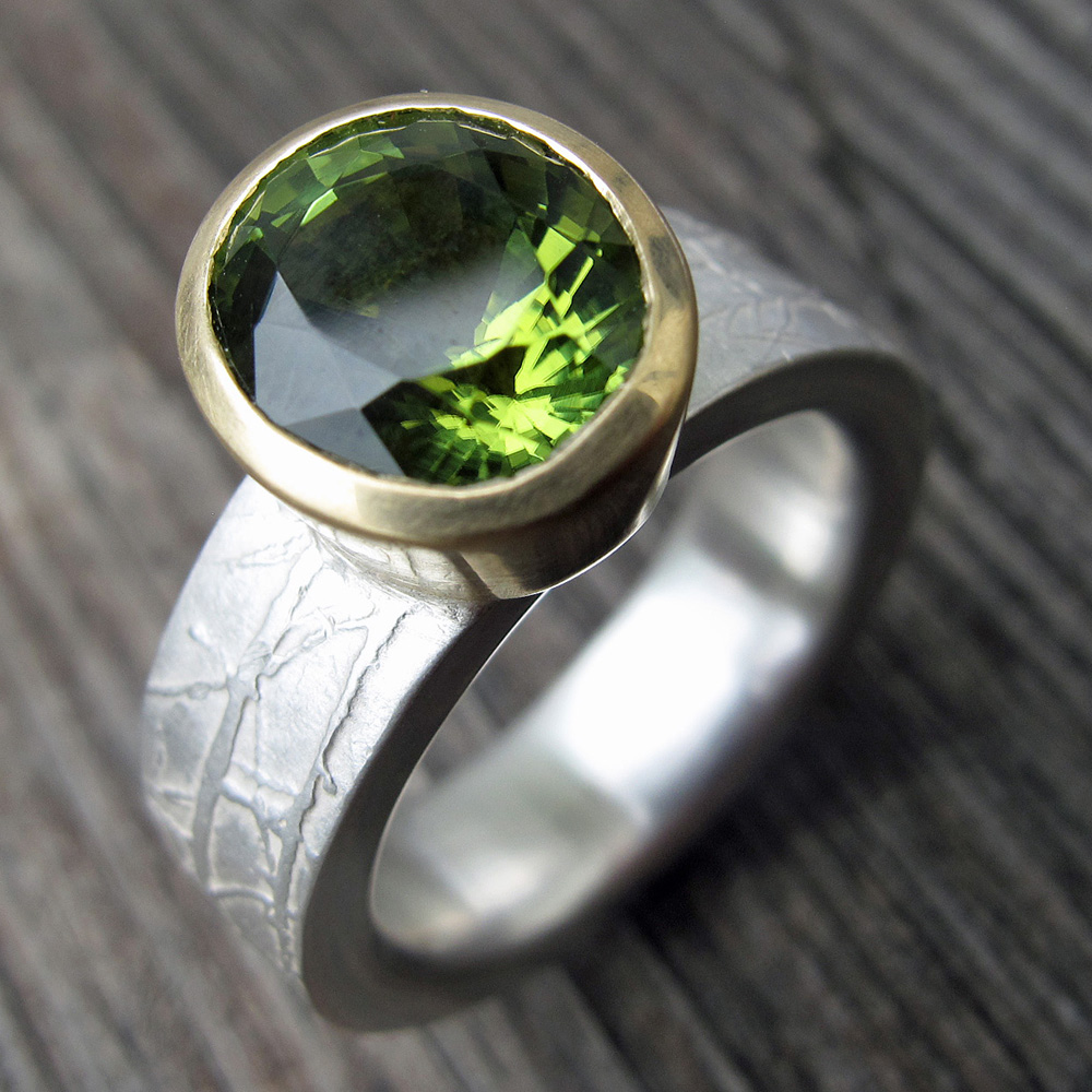 Peridot gold and etched silver engagement ring