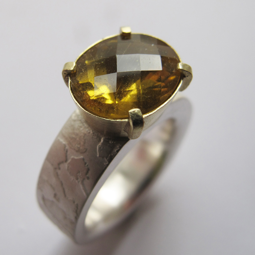 Yellow beryl gemstone ring with etched silver and gold