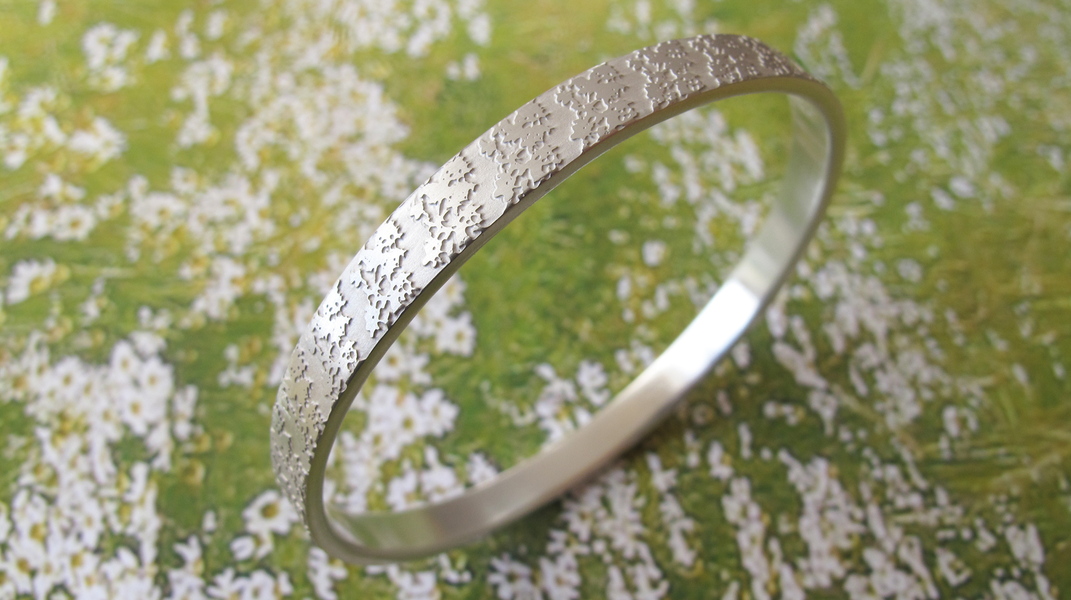 etched silver bangle commission sally grant jewellery.jpg