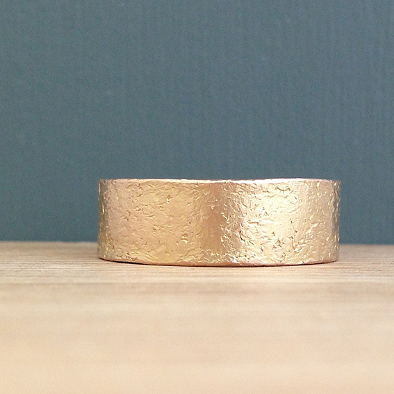 Textural etched rose gold ring.