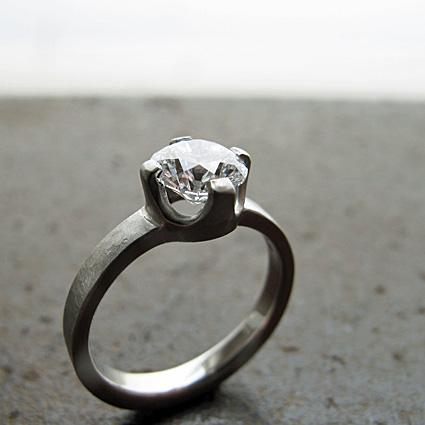 Textured platinum and Canadian diamond engagement ring.