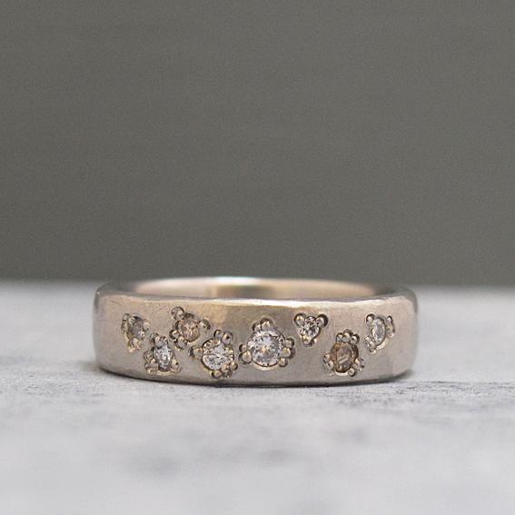 Textured platinum wedding ring.