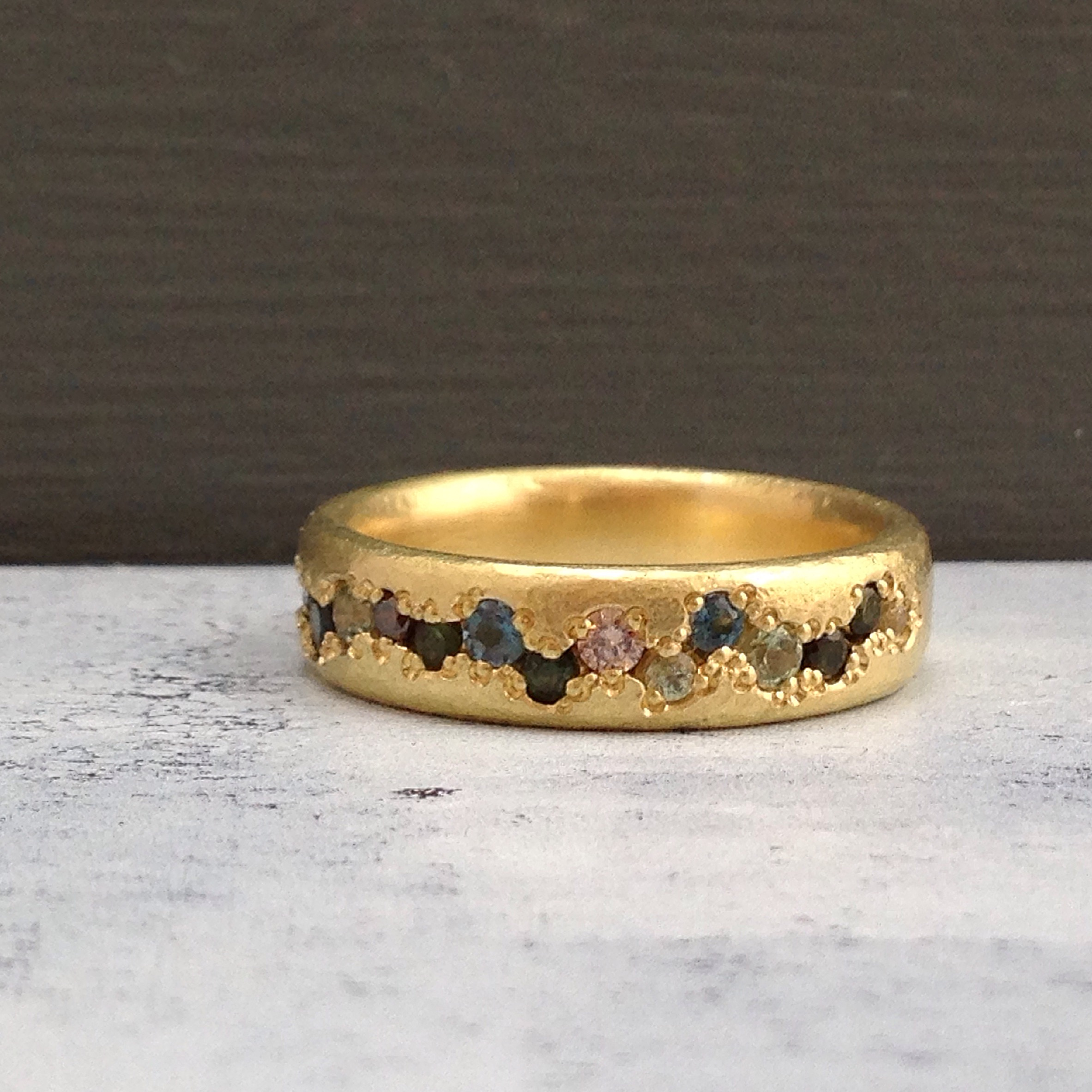 organic pave set textured gold eternity ring diamonds, sapphires, topaz and tourmalines.JPG