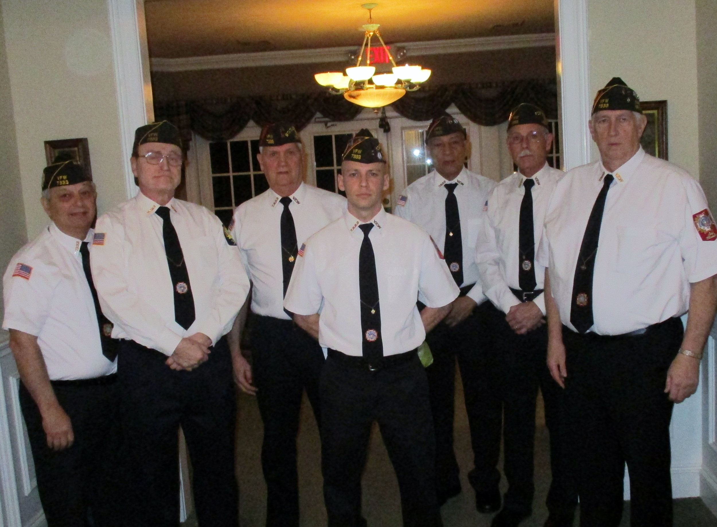 VFW Memorial Service was conducted by ( left to right): Rich, Bill, Jack, Scott, Emerson, Bryan and Dan.