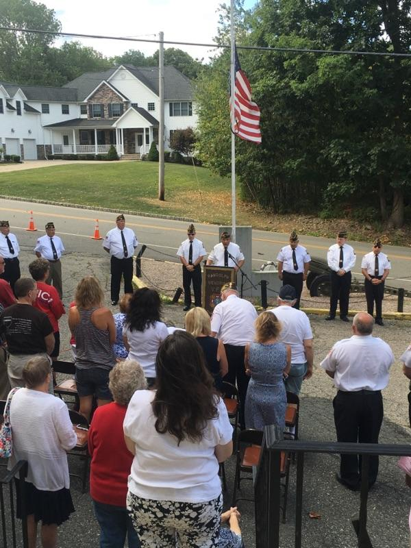 Singing of God Bless America led by Emerson