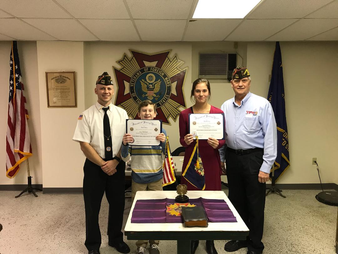 Patriots Pen winner Ryan Manderioli and Voice of Democracy winner Elizabeth Moran with Commander Montanio and Post Programs Chairman Sassaman.