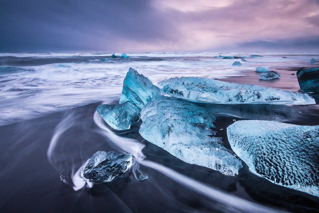 This image was made on the beach side of the lagoon.  It is a long expanse of smooth black sand.  In the winter, it is littered with large and small chunks of ice.  The trick is to find the perfect combination of ice, and to use a long enough exposure, to get those pretty trails of milky water as the tide flows back out to sea.