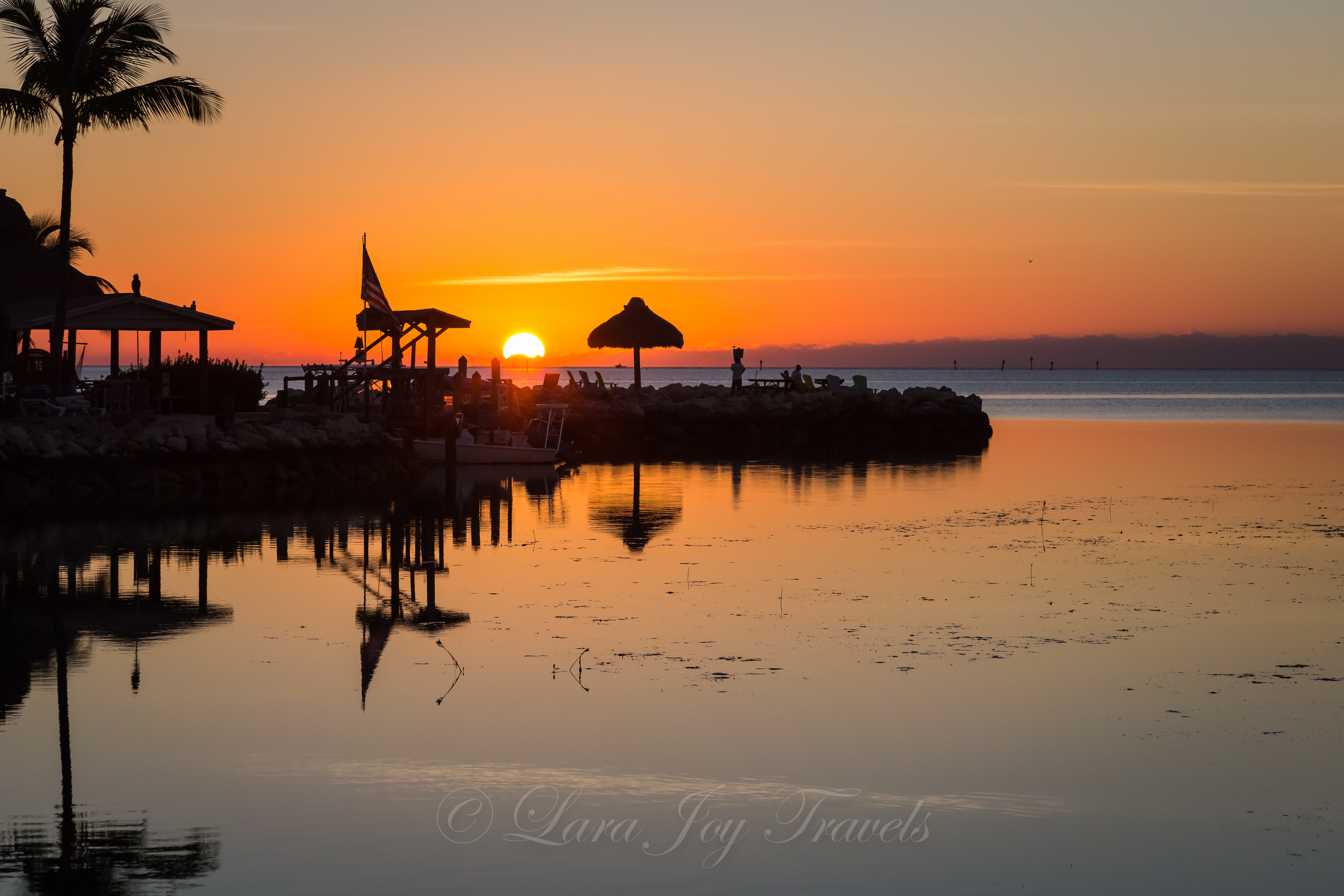 I set up on the beach at Drop Anchor and got this fun shot of the sun coming up over the horizon.