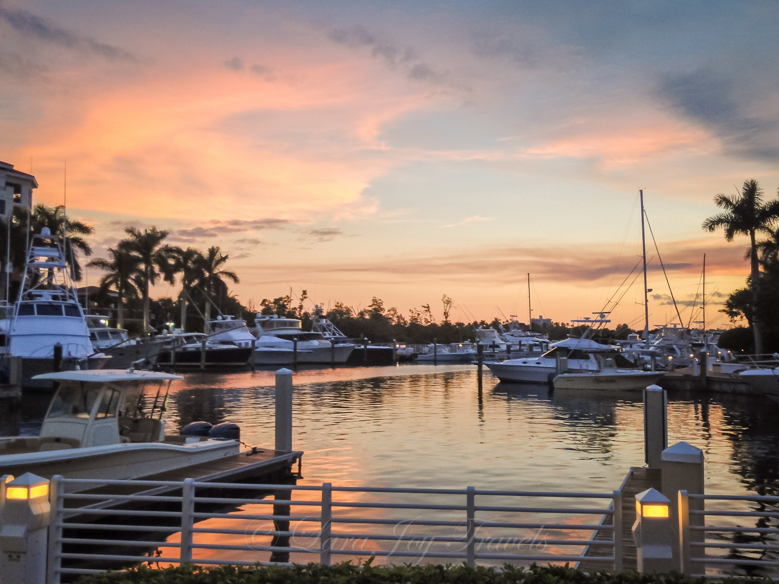 """Not only did I not have my dSLR for this sunset, but there was an annoying building blocking it as well. After dinner, I walked along the dock and found the perfect sunset spot for """"next time."""""""