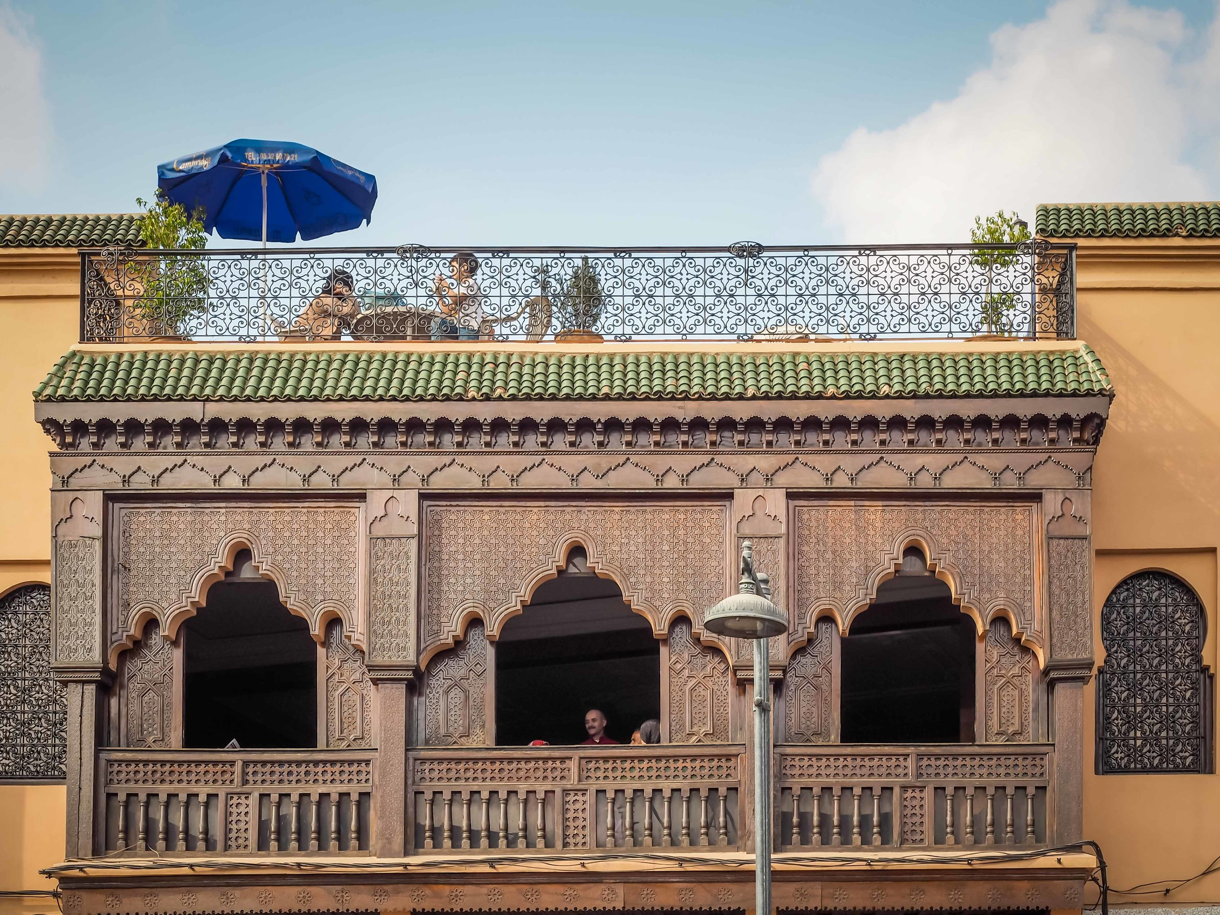 """Morrocan rooftop terraces are popular places for cafes. There really aren't any """"backyards"""" or gardens so rooftop terraces and inner courtyardsare welcome respites from thecrowds inMarrakech."""