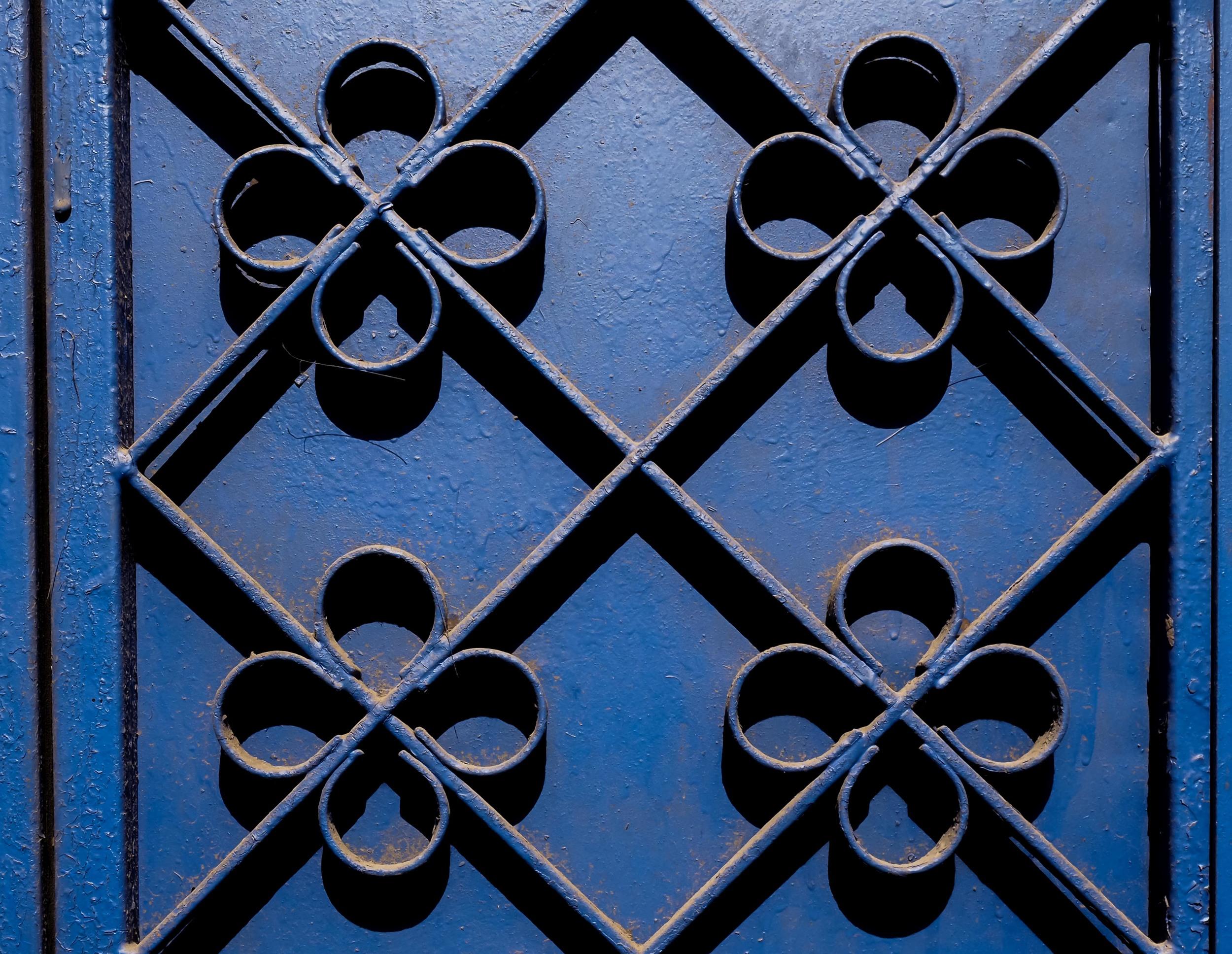 A detail of a deep blue metal door in Marrakech.
