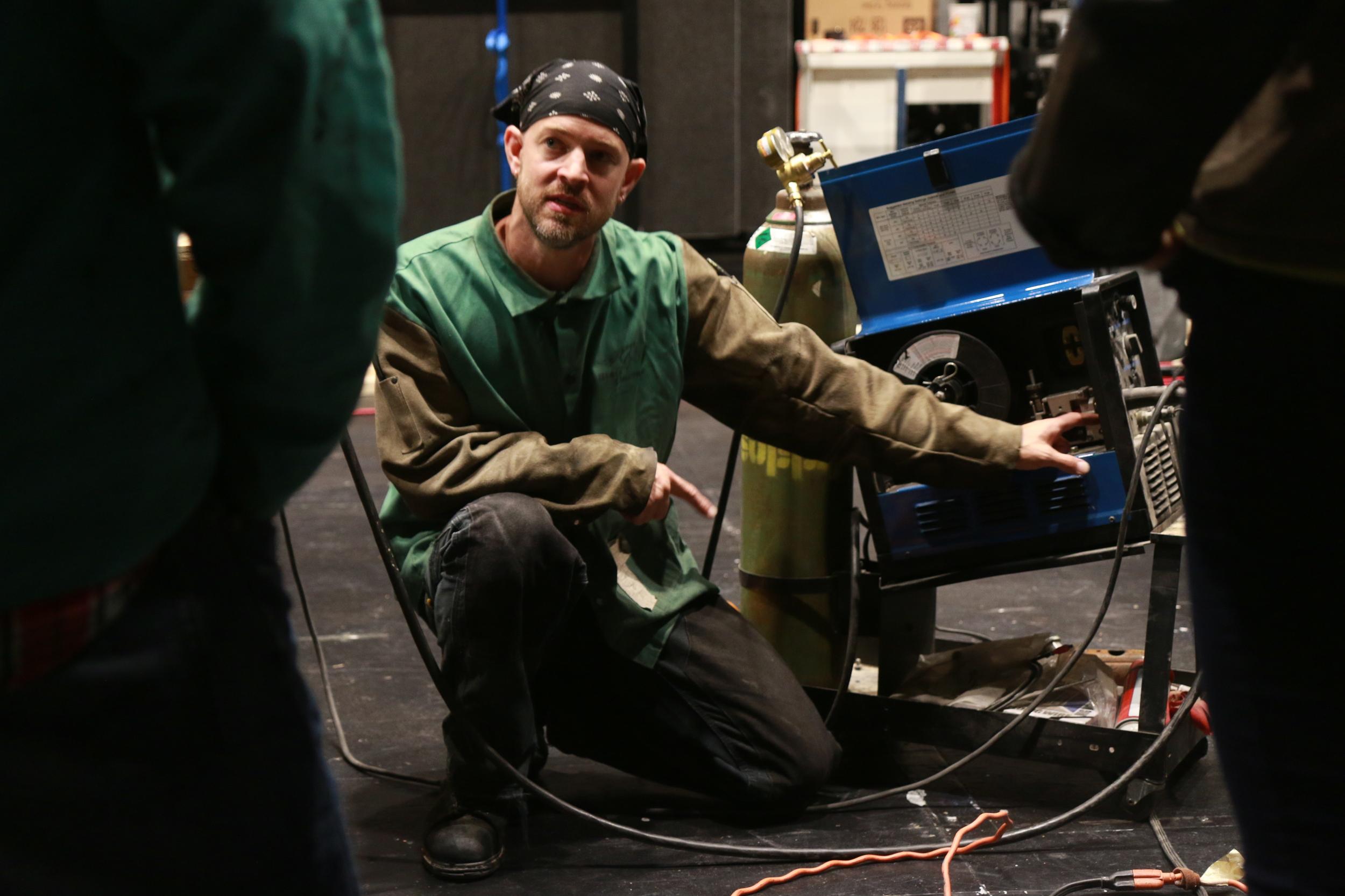 Guthrie Lead Carpenter Nate Saul explains the guts of a welder.
