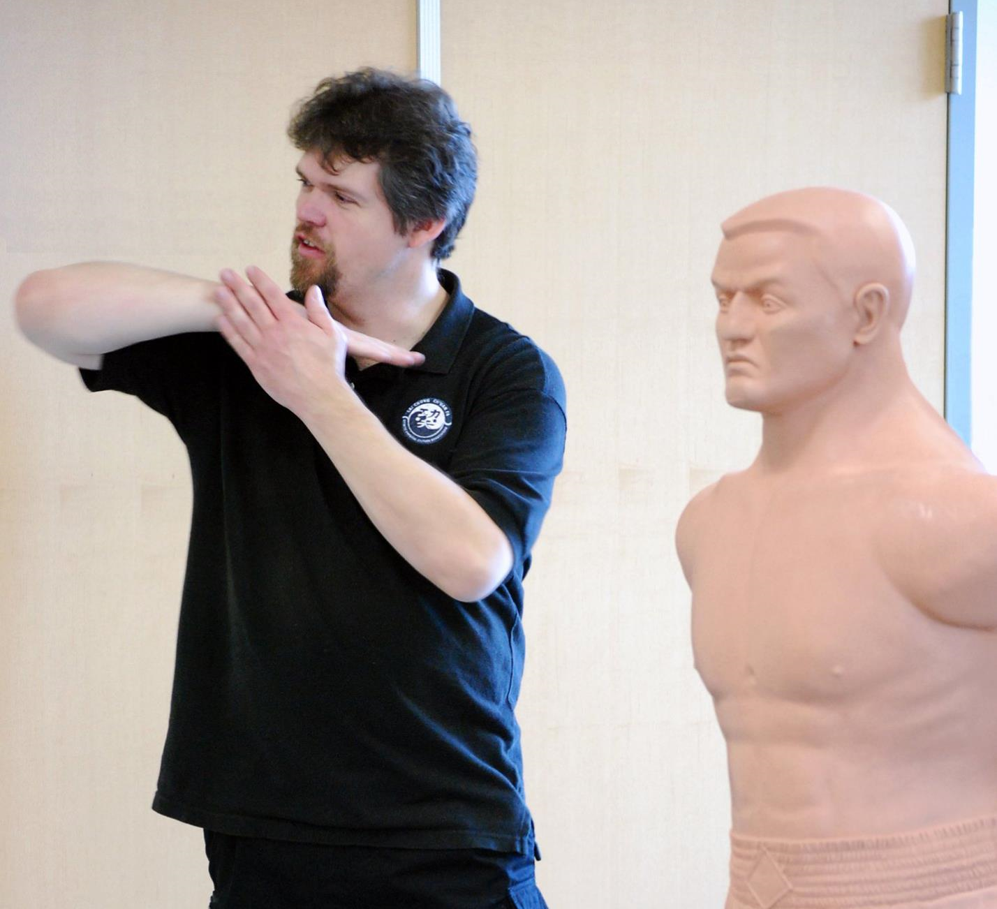 Sifu Jason demonstrating an inward elbow strike.  He always enjoyed showing some of the particularly effective strikes and target areas.
