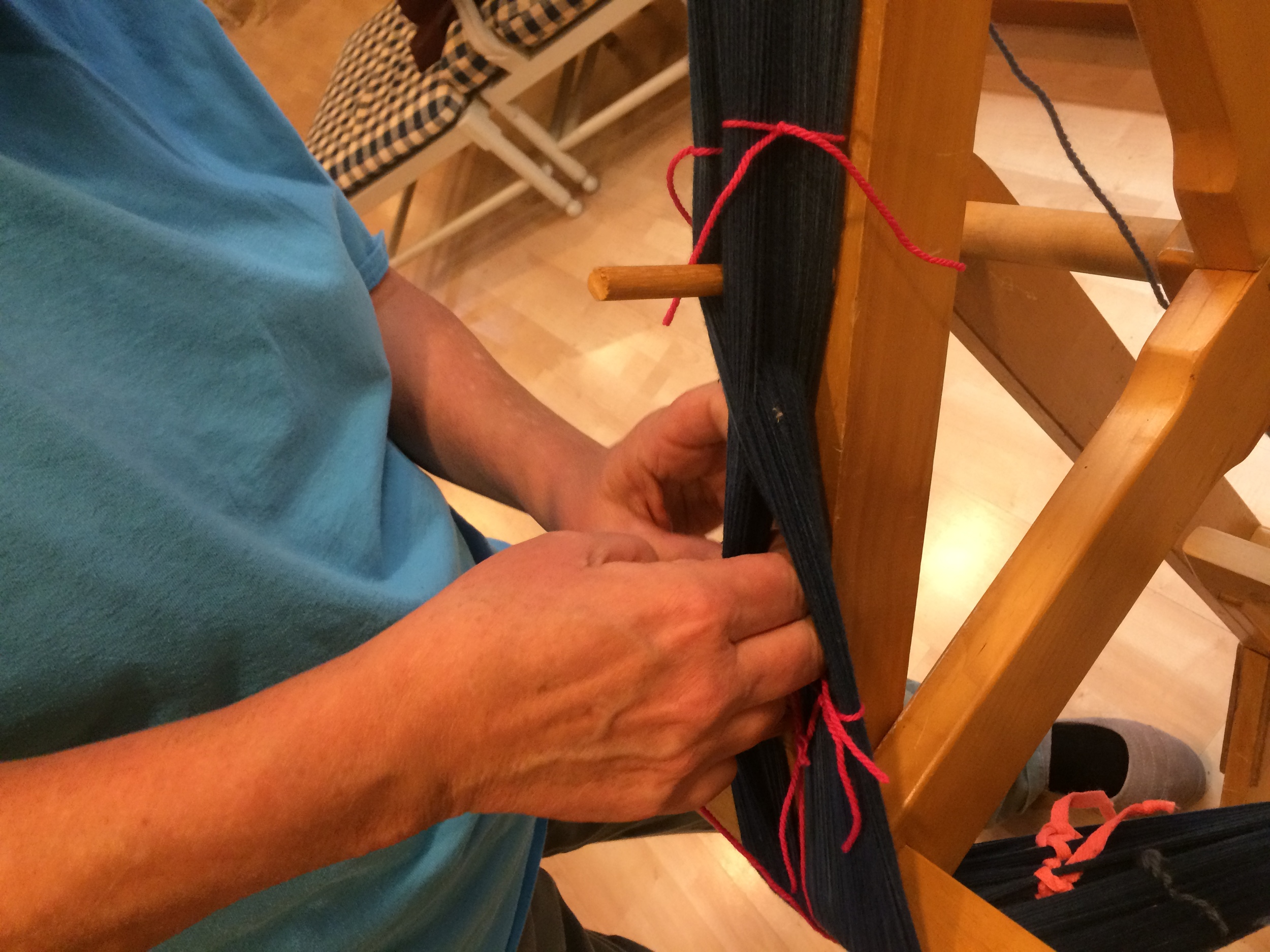 Tying off the yarns on warping frame.