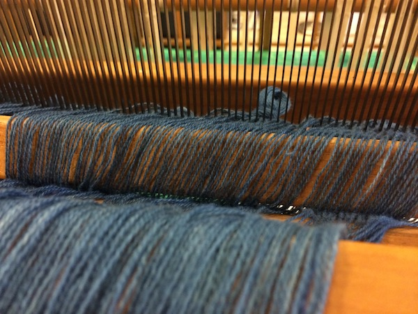 Once they are through the read, tie warp threads in bundles to keep them organized and prevent them from slipping through.