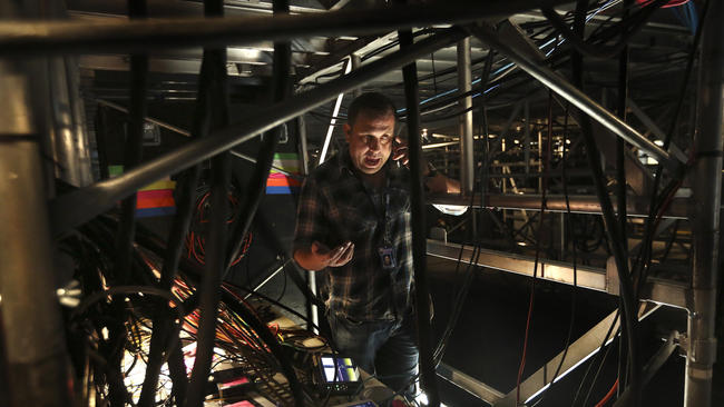 Jon Zucino works on installing fiber-optic lines for this year's Grammy Awards show at Staples Center.(Mel Melcon / Los Angeles Times)