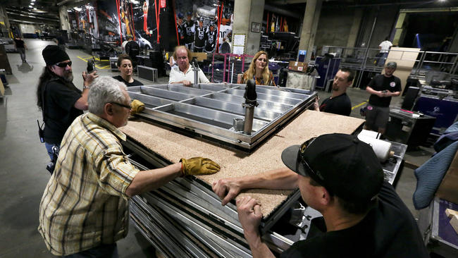 Members of the prop department prepare to move a stage floor that will be used during a performance at the Grammy Awards.(Mel Melcon / Los Angeles Times)