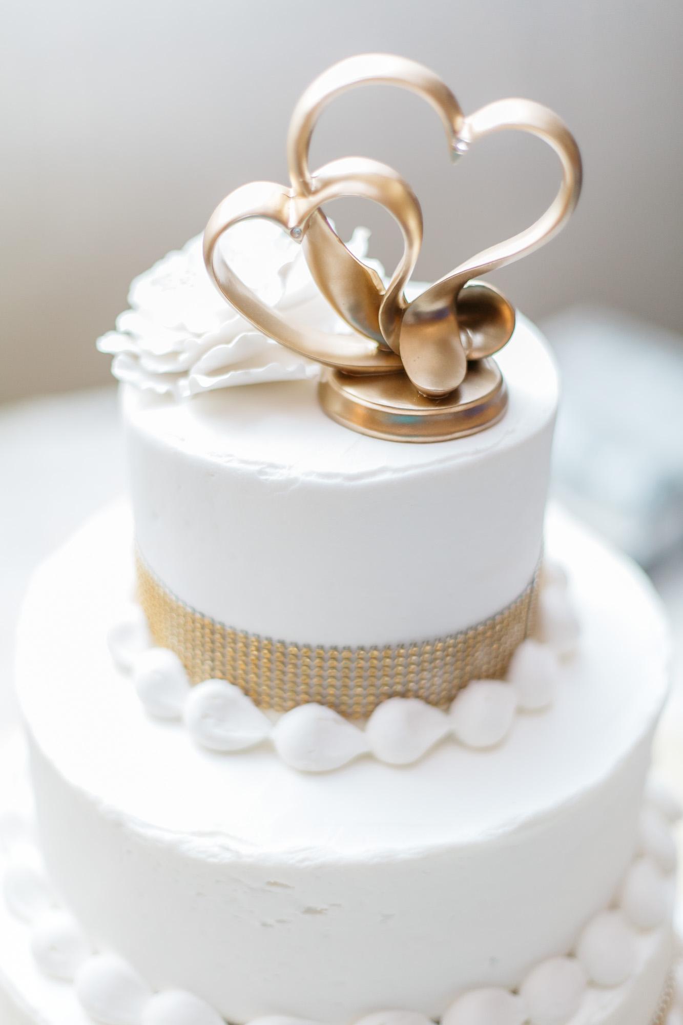 Kristin + Will   White and Gold Wedding Cake   Cornerstone Family Life Center Wedding Reception  Greenville NC Wedding Photographer   Bryant Tyson Photography   www.memoriesbybryant.com