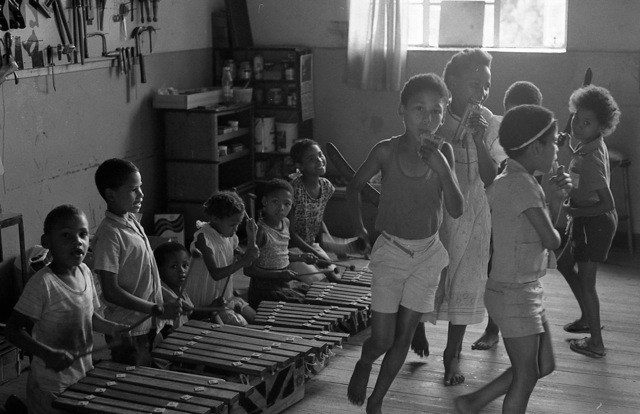 "Kids on marimba, and pipe-dance in the Kwangoma workshop, Suurbraak. ""They would regularly come around and play!"""
