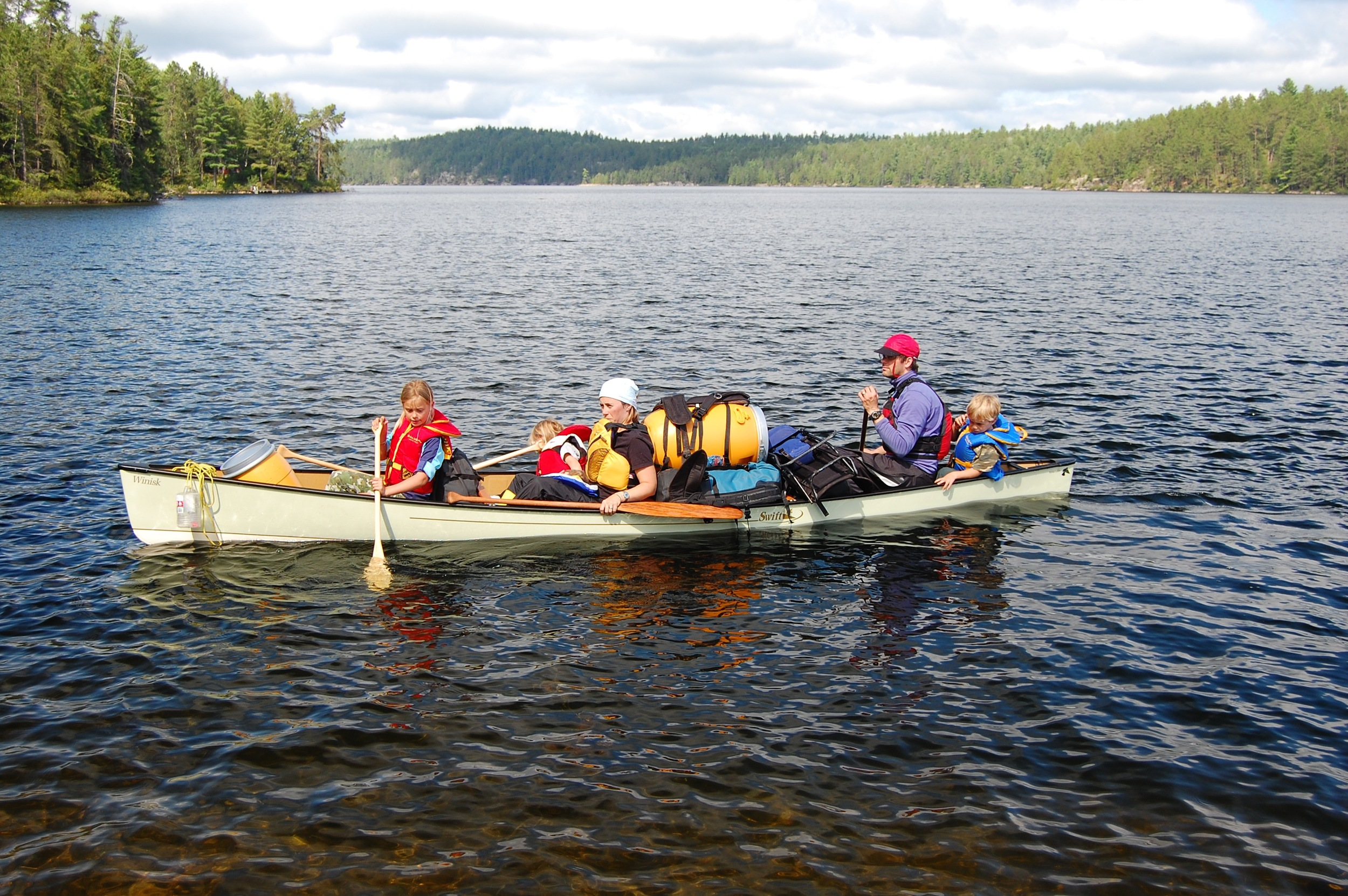 Two adults and four children and all of their gear in a single canoe (the Swift Winisk).  Photo by Dave Smilek