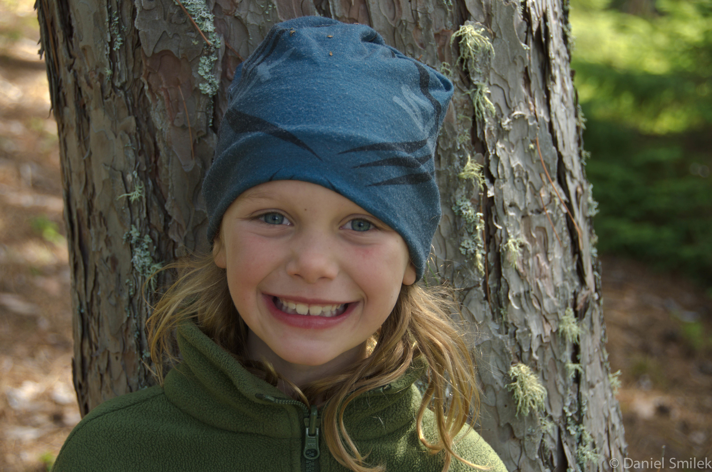 Cousin Eva wearing her Buff while camping in the backcountry.