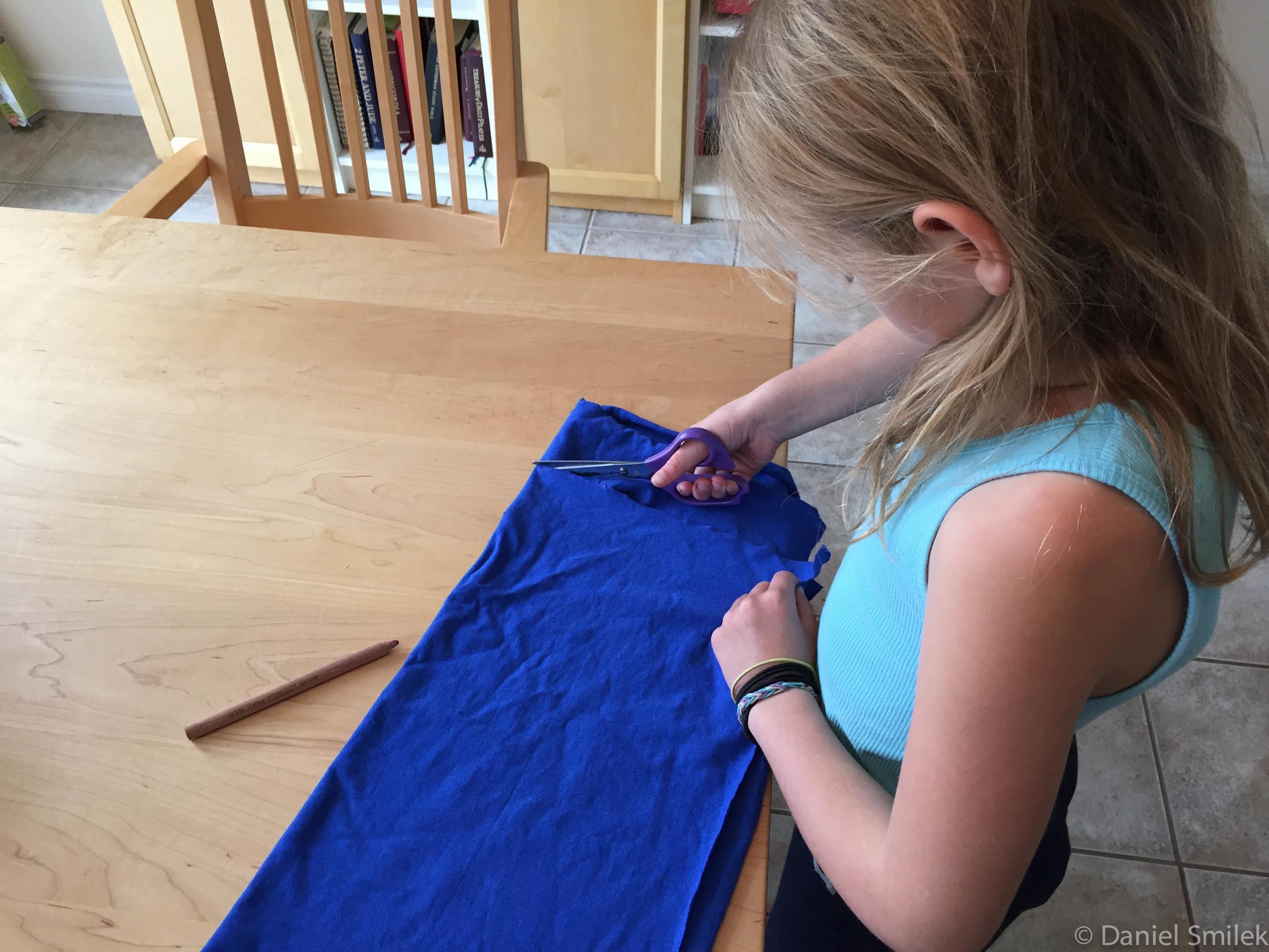 Cousin Eva cutting out her tubular bandana.