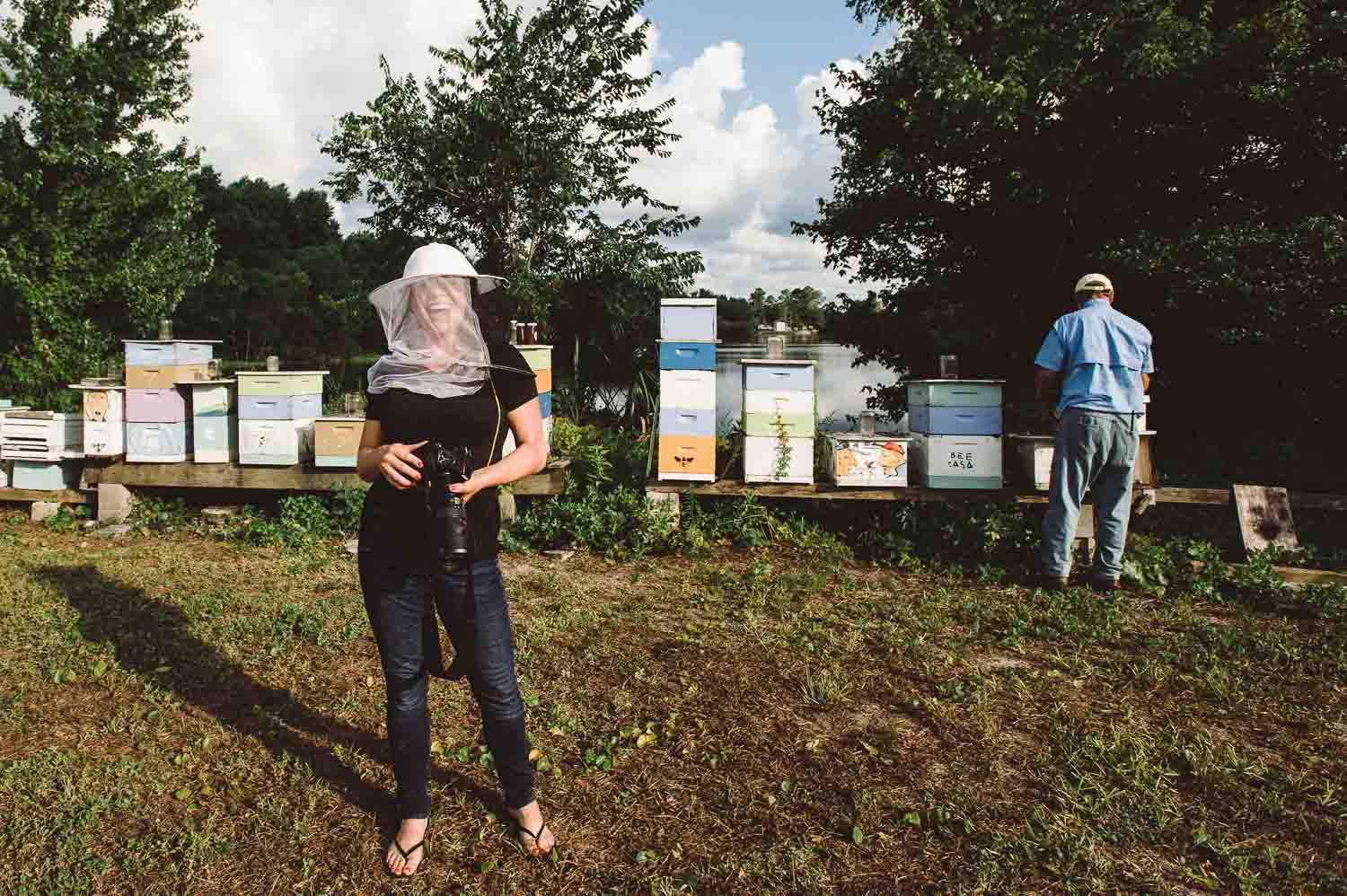 Kristen Penoyer, a Jacksonville, Florida food photographer works with beekeeper, Bo Sterk.