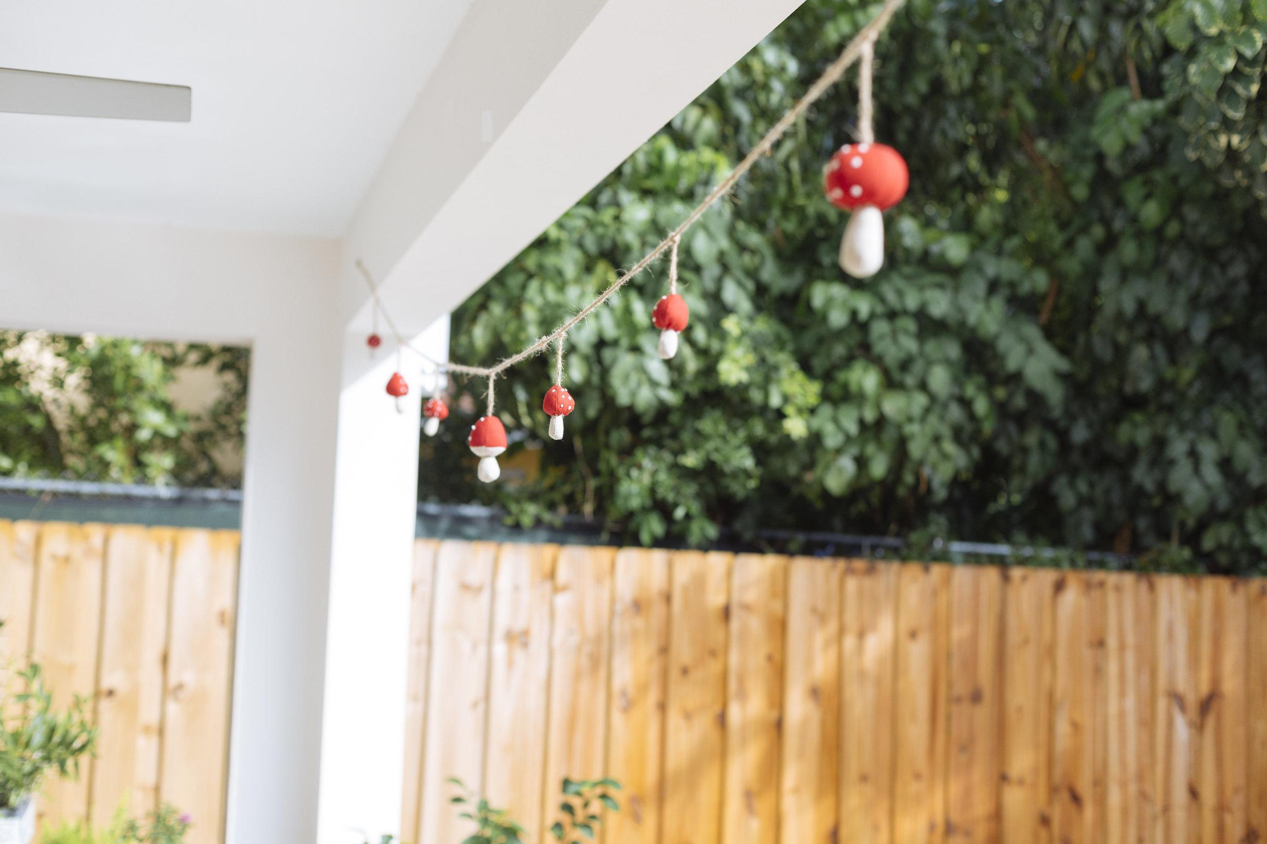 garland made with ikea christmas mushroom ornaments