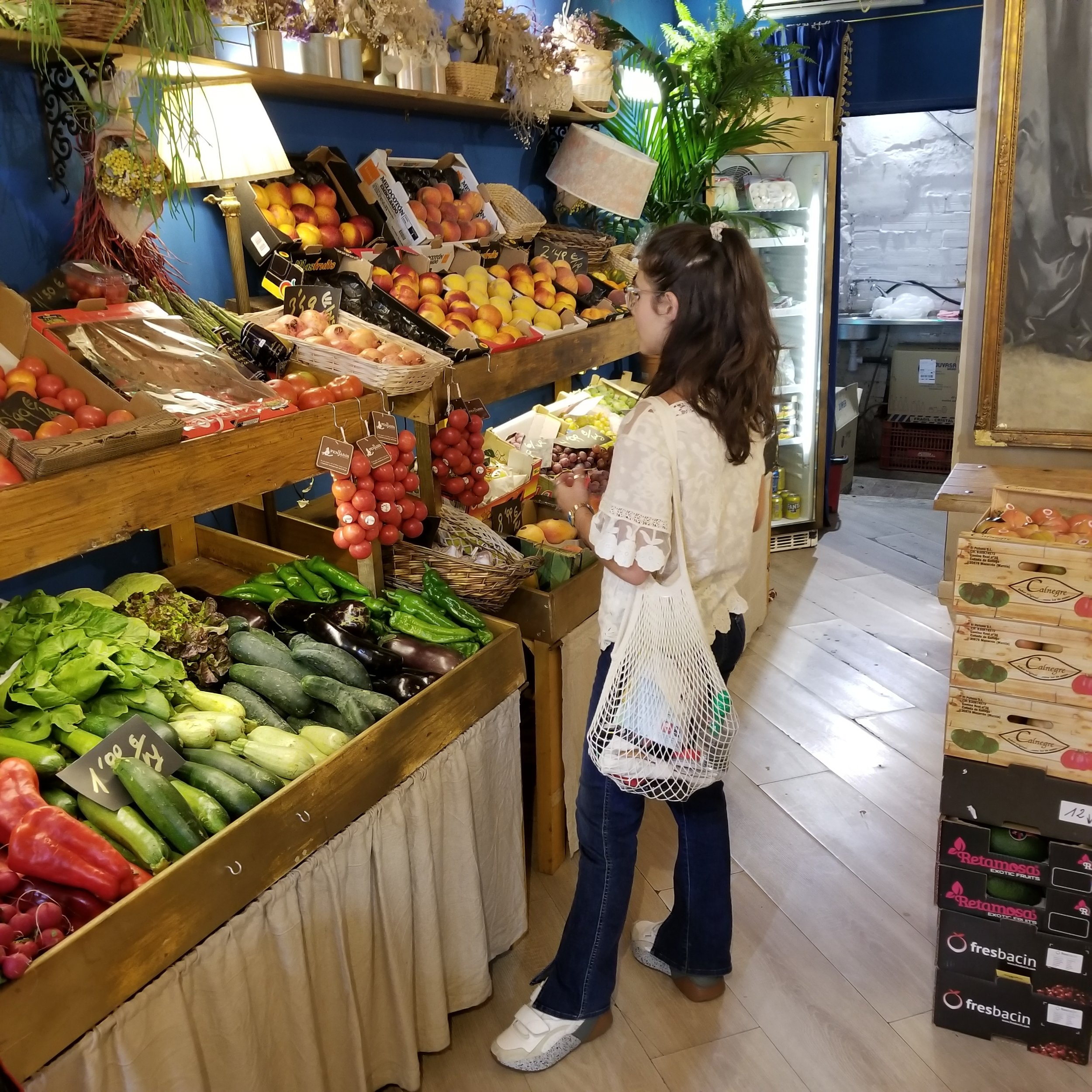 Buying fruits and veggies to cook in the Airbnb