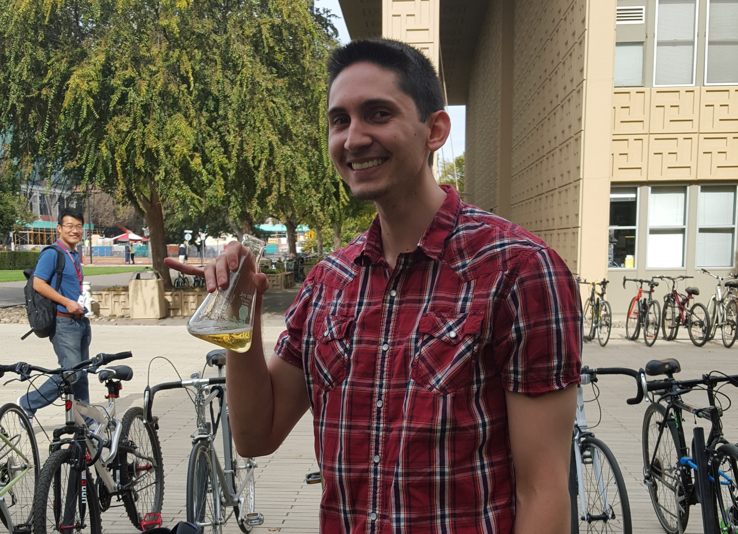 Brayon passes his quals - and drinks from the lab trophy!