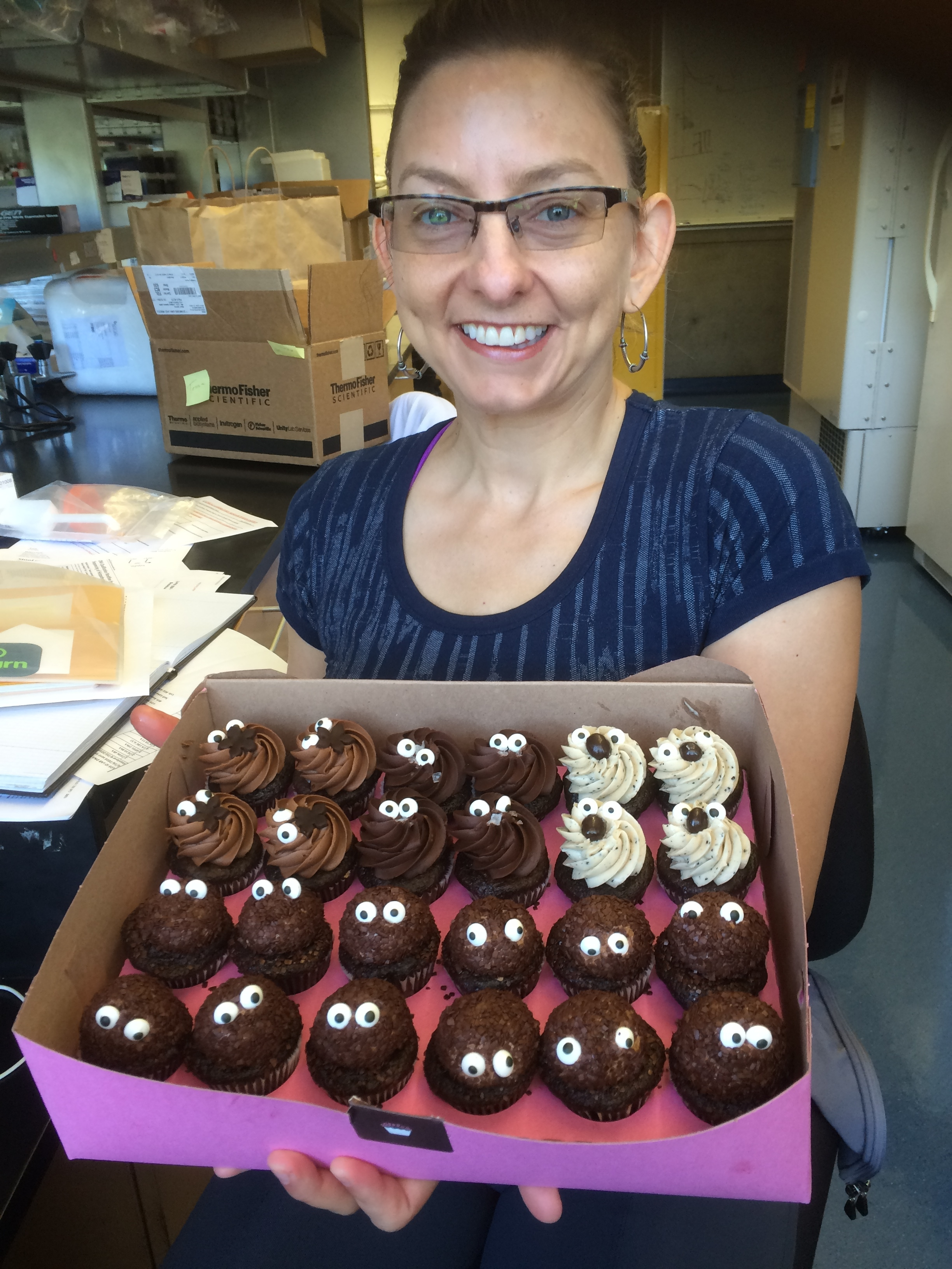 Tessa thanking our stool collection nurses with poop emoji themed cupcakes!