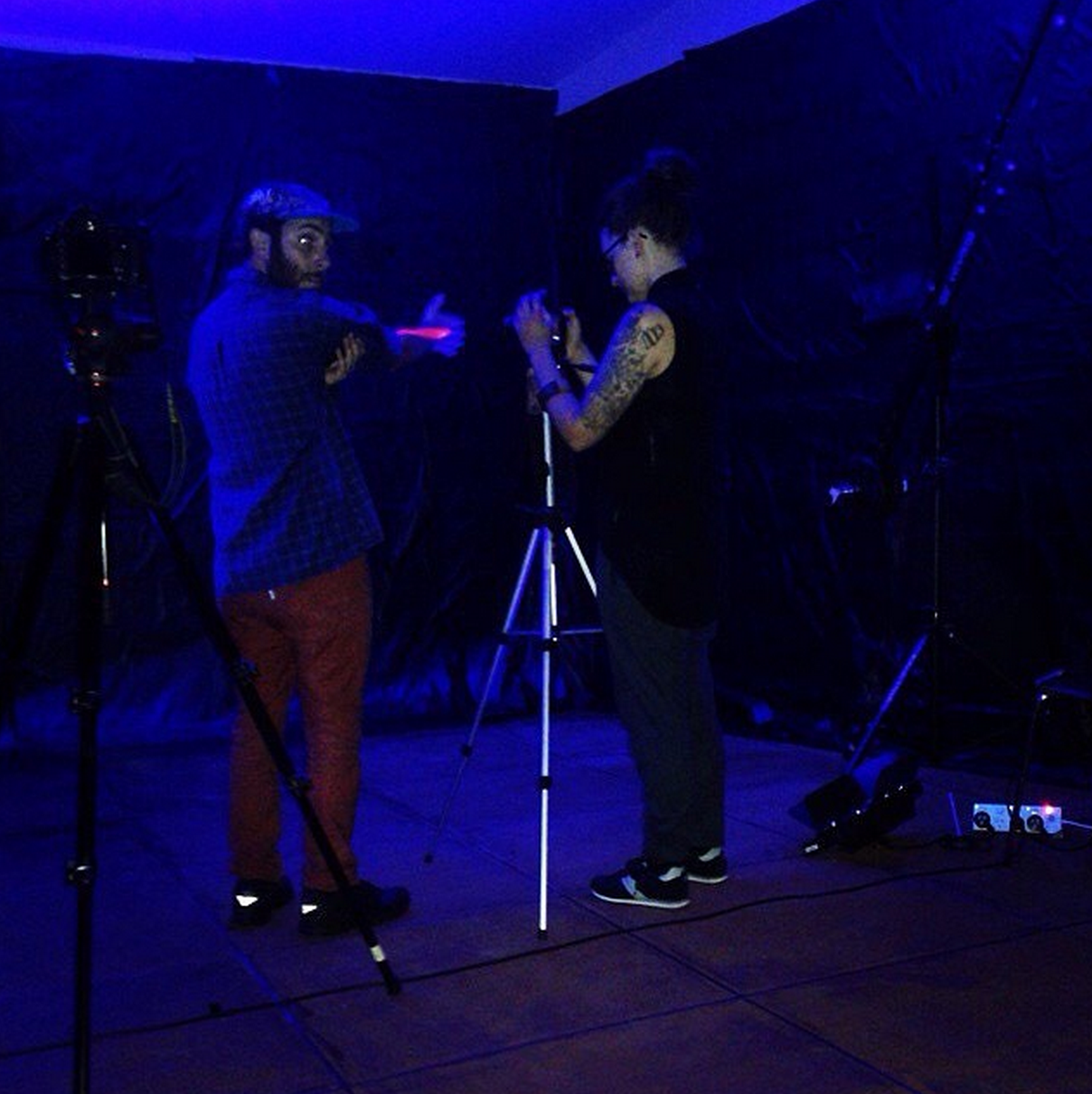 Mark + Sophi testing out the blacklight paint on camera before bringing in Hannah. Photo by Tama Owens.